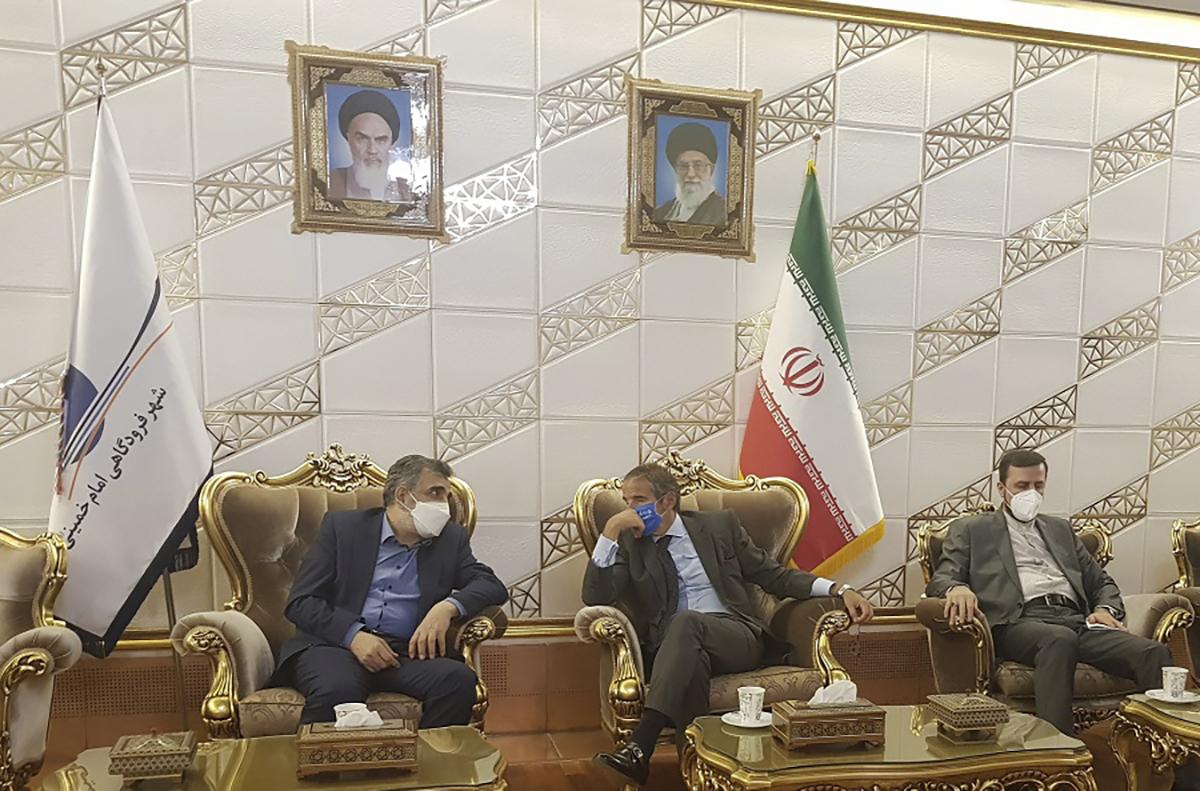Director General of International Atomic Energy Agency, IAEA, Rafael Mariano Grossi, center, speaks with Deputy Head of the Atomic Energy Organization of Iran, Behrouz Kamalvandi, left, upon his arrival at Tehran Imam Khomeini International Airport, Iran, on Sept. 11, 2021.