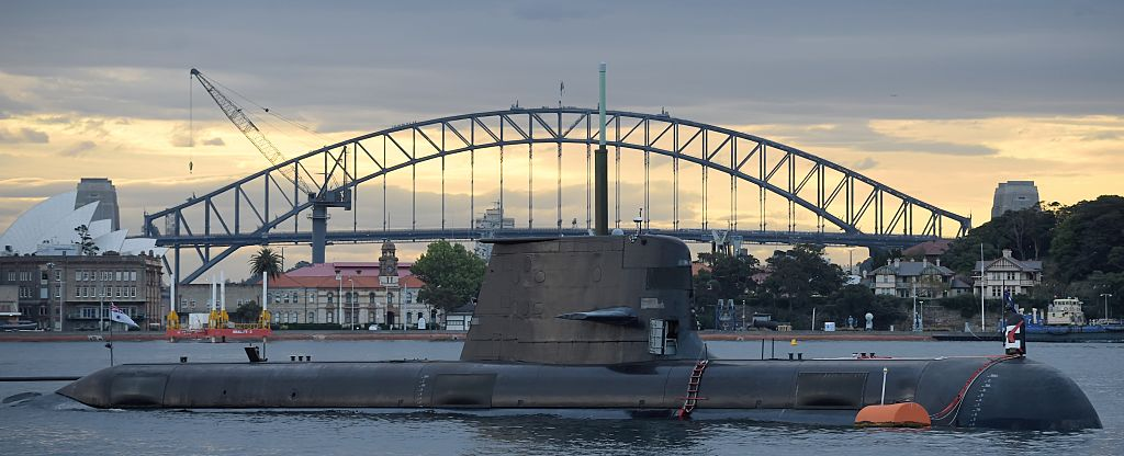 In this photo taken on October 12, 2016, a Royal Australian Navy diesel and electric-powered Collins Class submarine sits in Sydney Harbor.