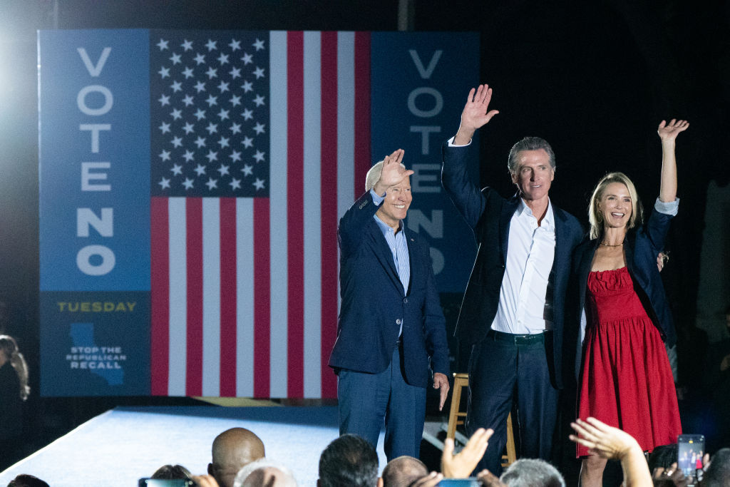 President Joe Biden, California Gov. Gavin Newsom and his wife Jennifer Siebel Newsom wave to the crowd during a campaign event at Long Beach City College in Long Beach, California, U.S., on Monday, Sept. 13, 2021. Polls show Newsom prevailing in the Sept. 14 recall, beating back a mostly Republican field of challengers.
