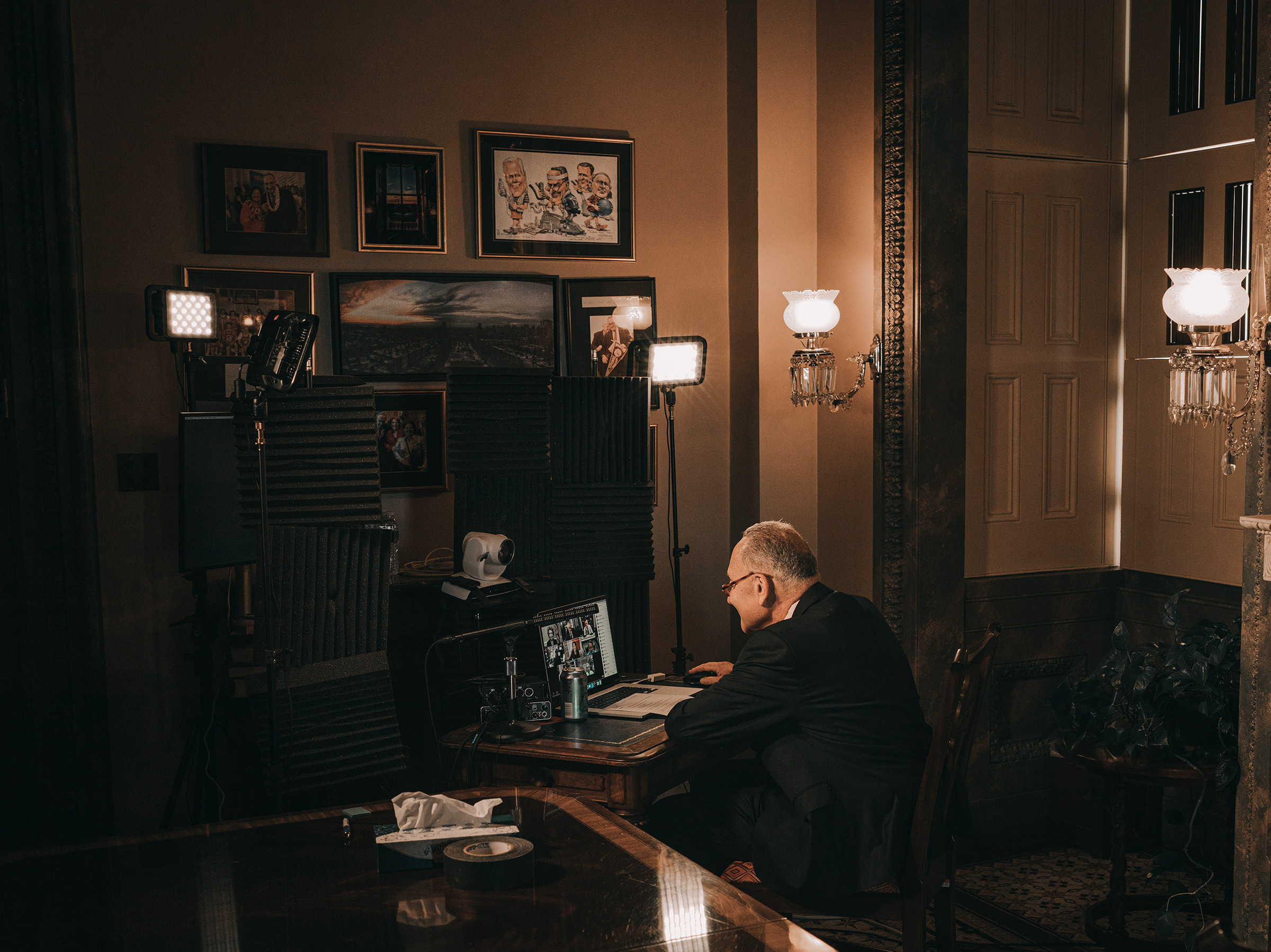 The majority leader works at the videoconferencing station in hisCapitol office