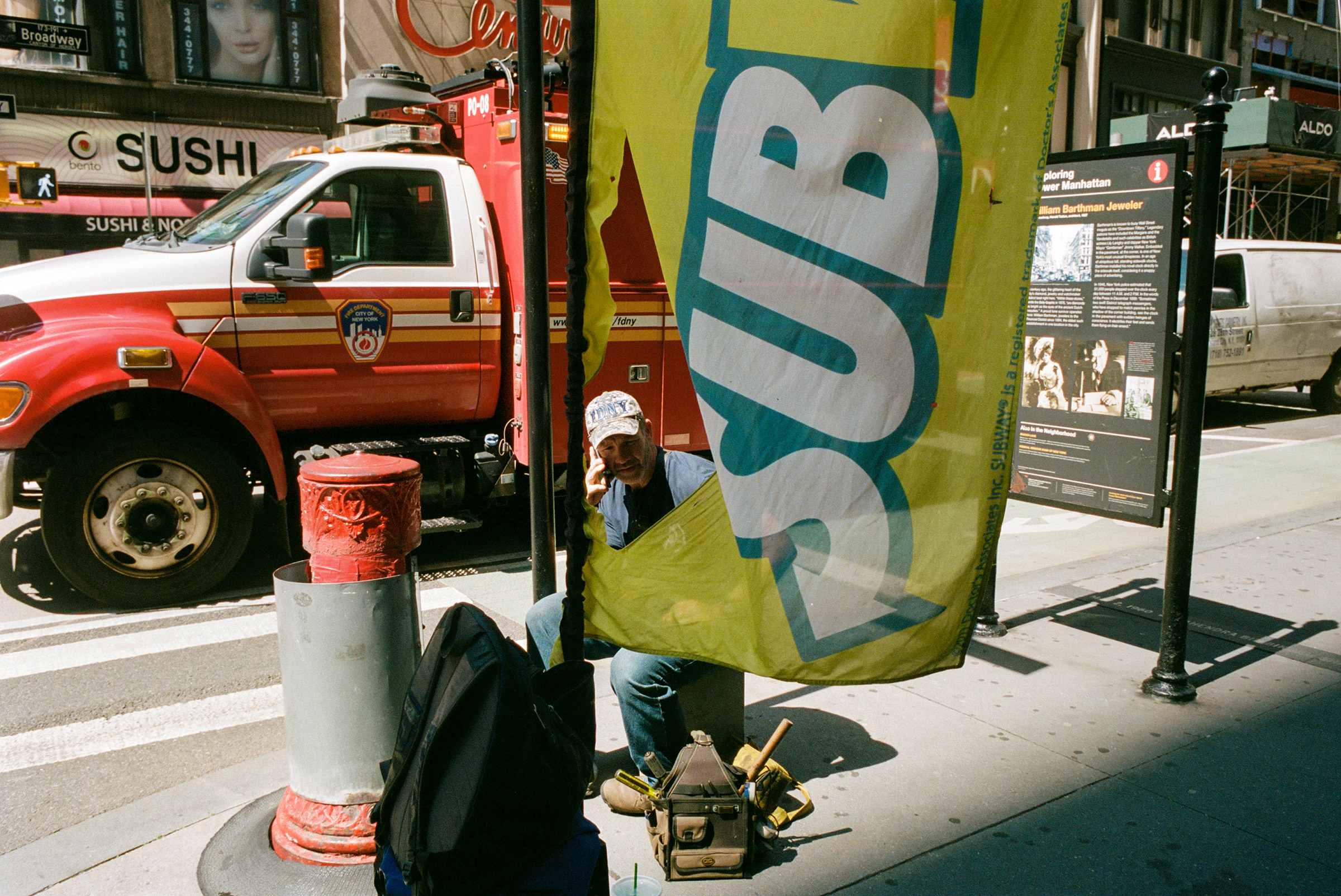 An FDNY repairman takes a break on lower Broadway, Aug. 25, 2021.