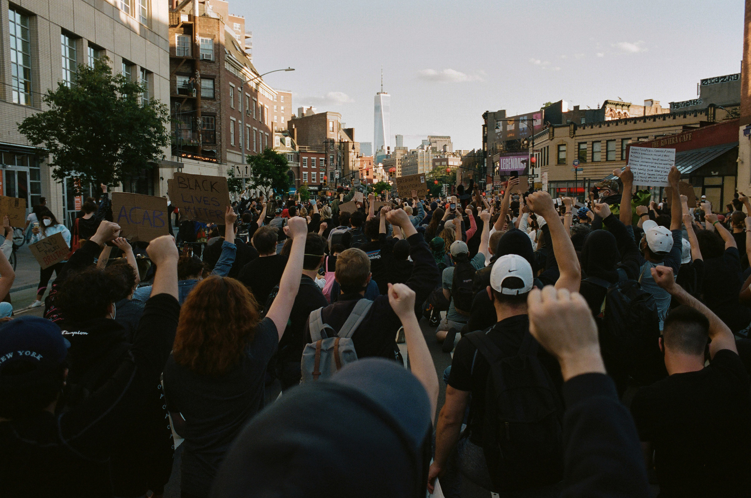 Black Lives Matter protesters take a knee while looking south down 7th Avenue toward One World Trade Center, June 4, 2020.