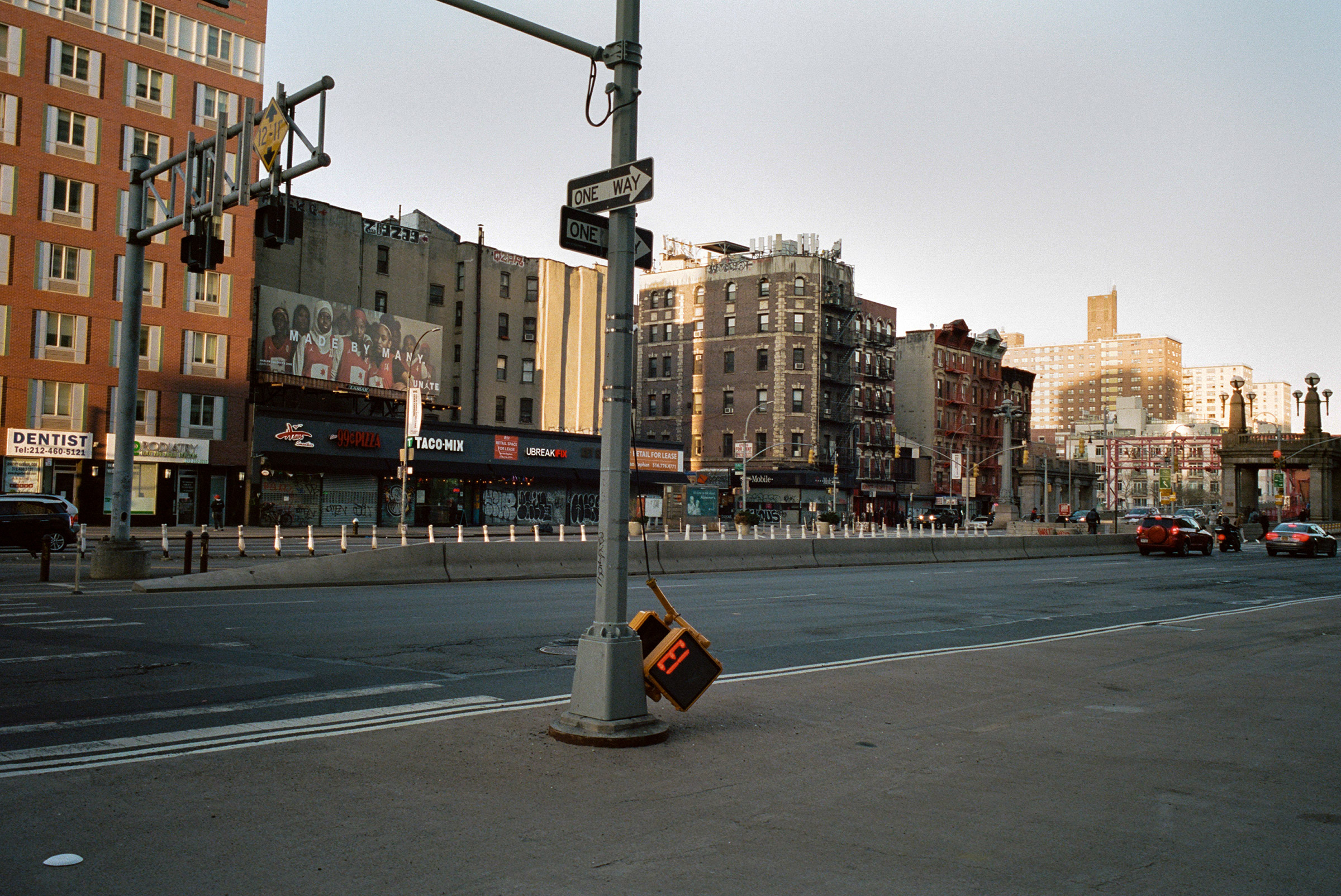 A broken streetlight flashes an ominous message on a deserted Delancey Street during the COVID-19 lockdown on April 14, 2020.