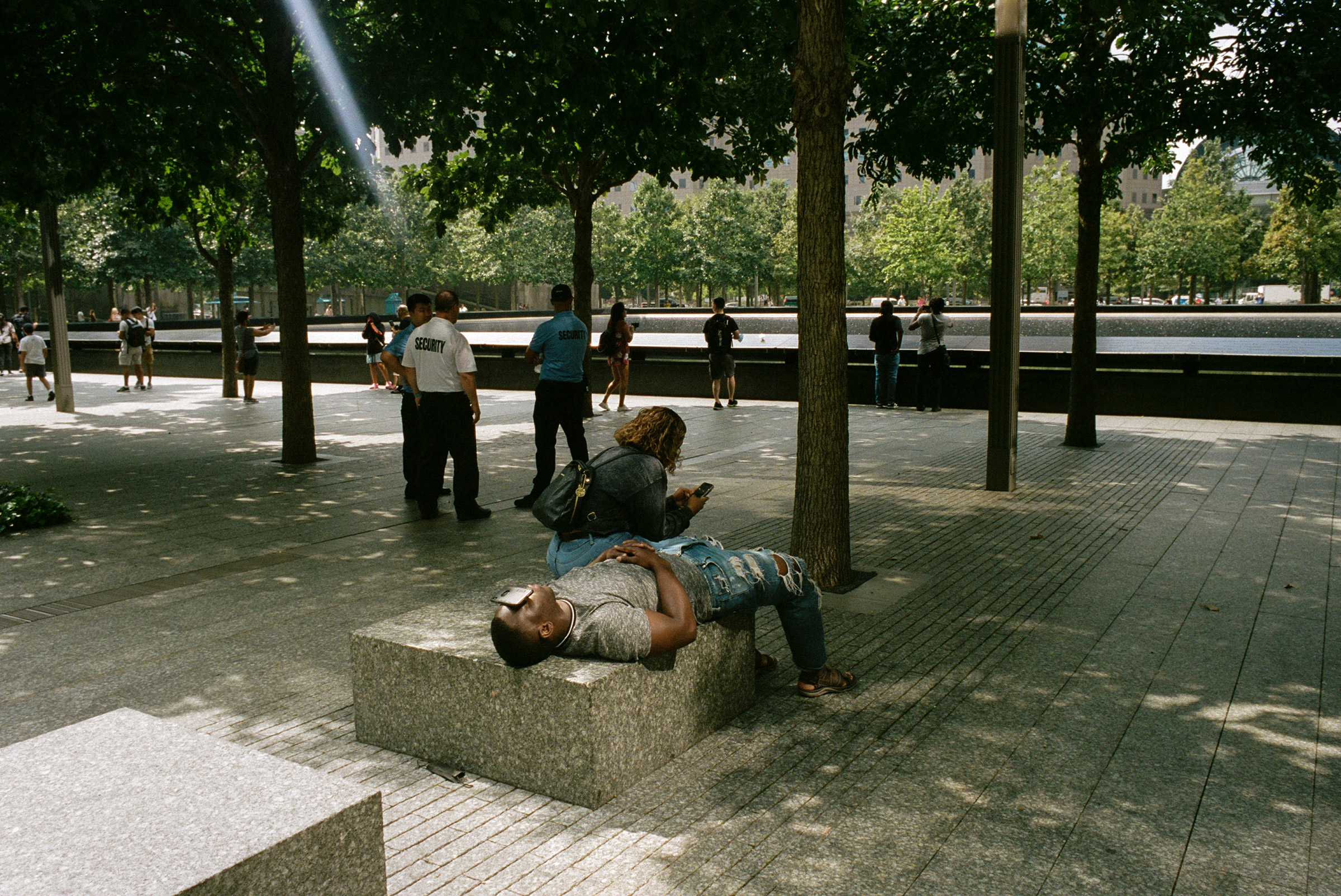 A man rests at the 9/11 memorial, Aug. 31, 2021.
