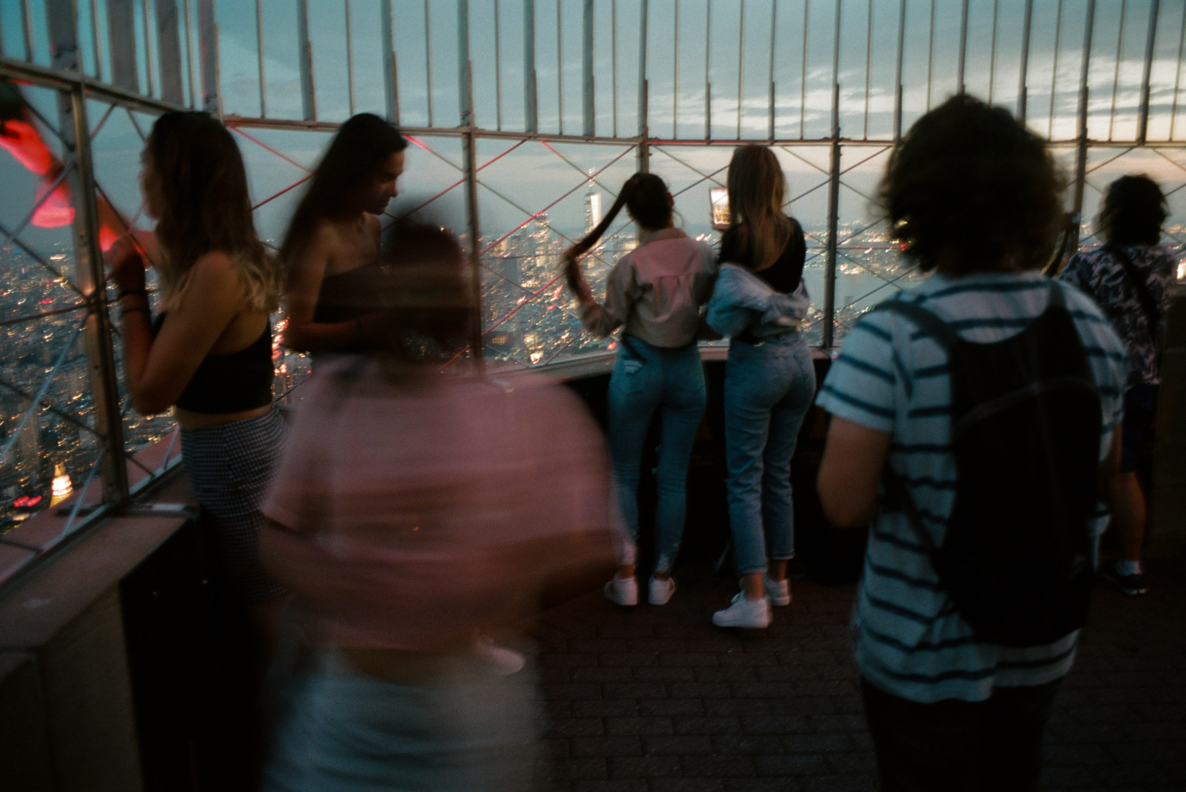 A group of young tourists at the Empire State Building observation deck gasp at the sight of the city from above, Sept. 1, 2021.