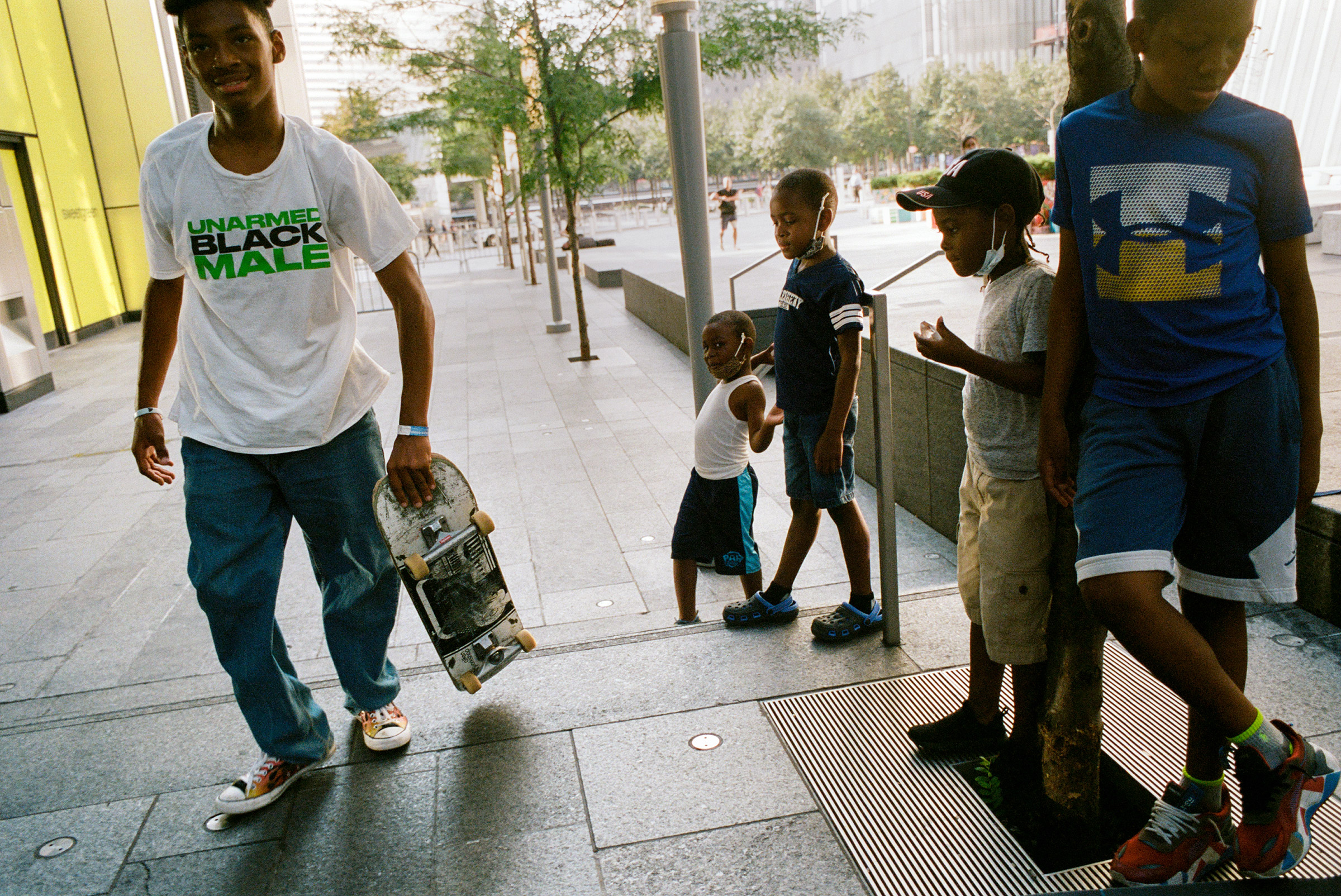 A group of kids admire a young skateboarder near One World Trade, Aug. 26, 2021.