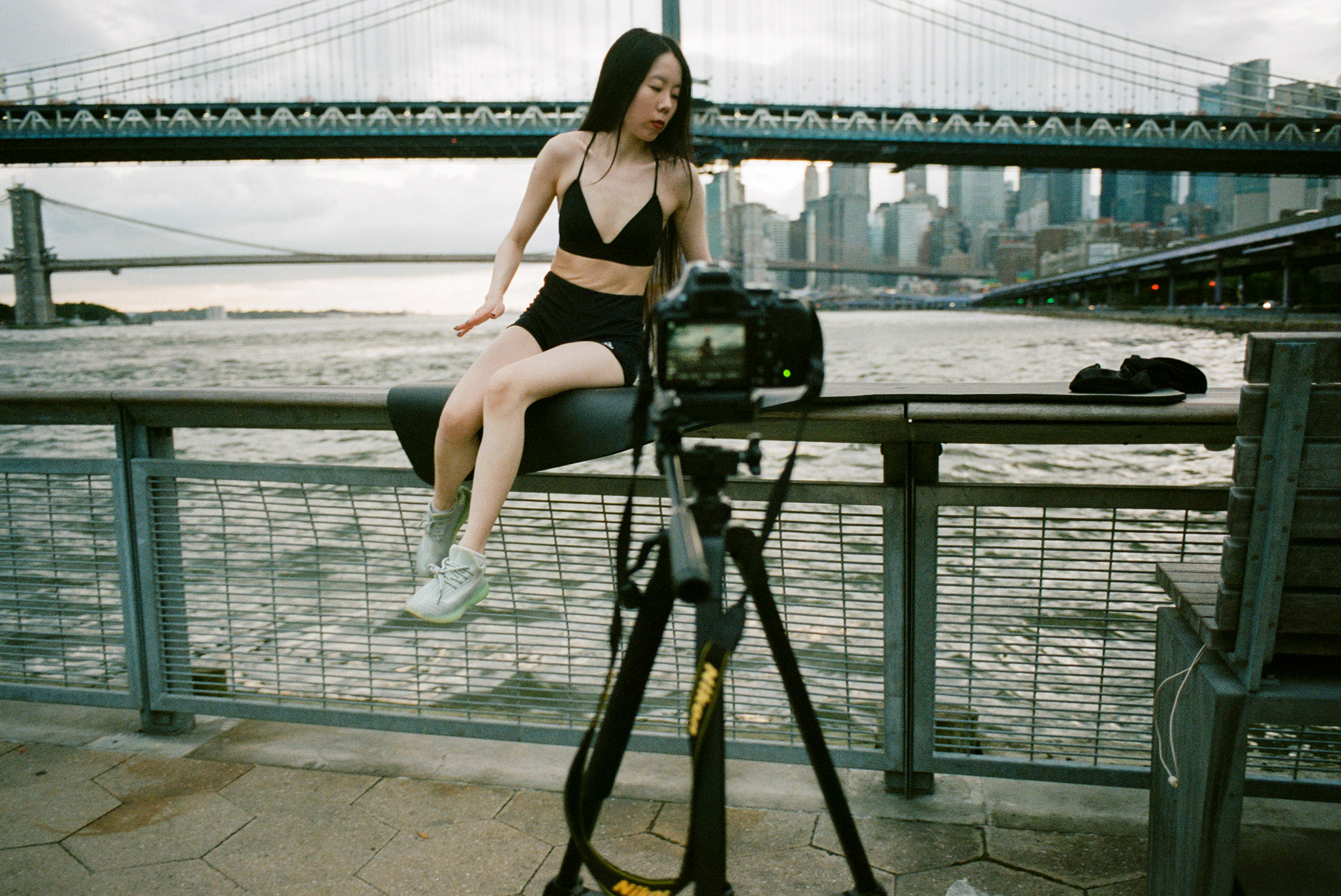 A thrill-seeking content creator balances on a narrow rail over the East River for a photo, Aug. 23, 2021.