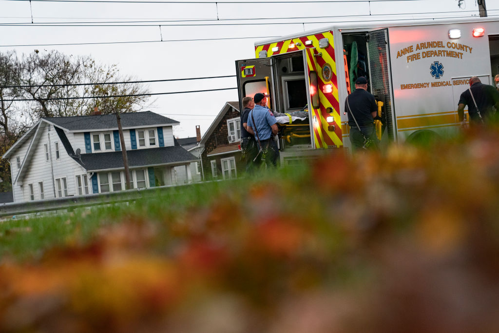 Firefighters and paramedics with Anne Arundel County Fire Department load a patient into an ambulance while responding to a 911 emergency call on November 11, 2020 in Glen Burnie, Maryland.