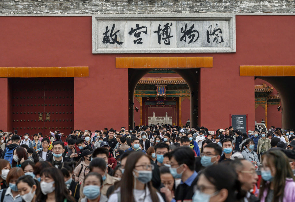 Chinese tourists crowd as they leave the exit of the Forbidden City on October 6, 2020 in Beijing, China.