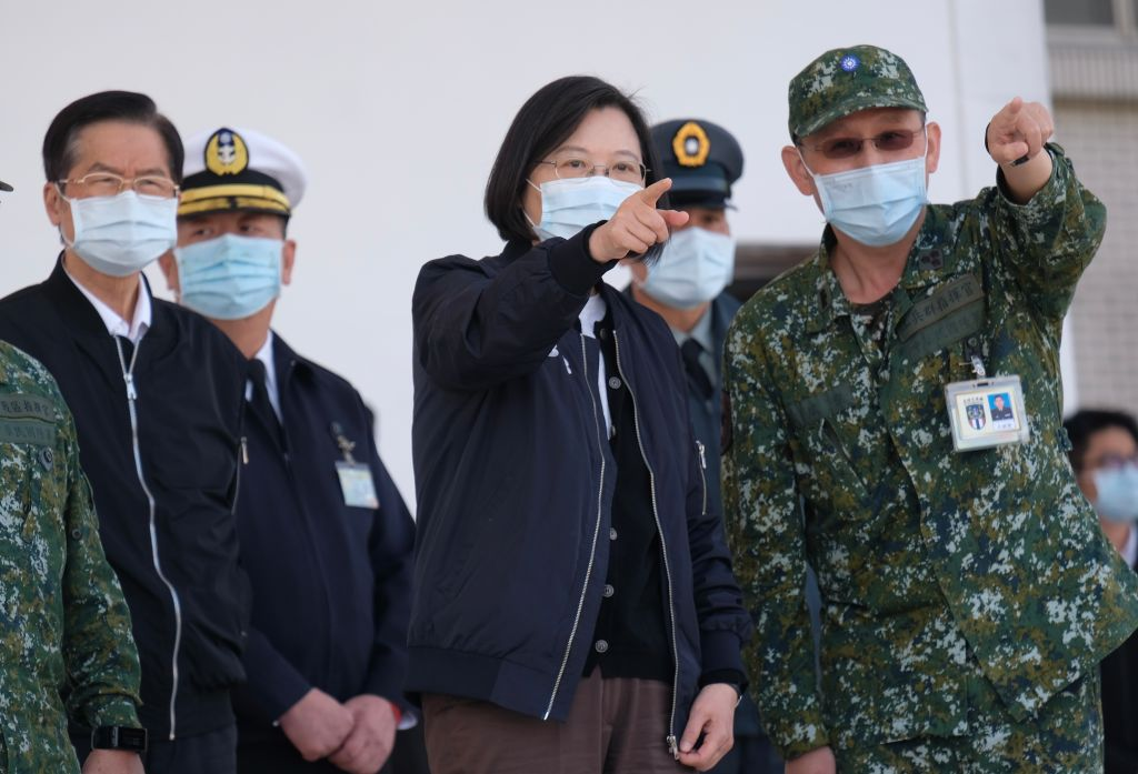 Taiwan's President Tsai Ing-wen (C) listens while inspecting military troops in Tainan, southern Taiwan, on January 15, 2021.