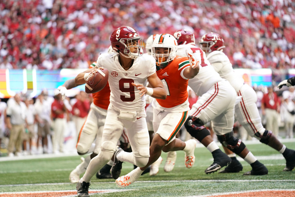 College Football: Alabama QB Bryce Young (9) in action vs Miami at Mercedes Benz Stadium on Sept. 4, 2021. Under the new NCAA rule changes, Young has reportedly signed name, image and likeness agreements worth more than $800,000.