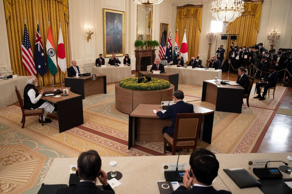 US President Joe Biden (2L), Indian Prime Minister Narendra Modi (L), Japanese Prime Minister Suga Yoshihide (C) and Australian Prime Minister Scott Morrison (Top C) sit down for the the first-ever in-person Quad Leaders Summit at the White House in Washington, DC on September 24, 2021.