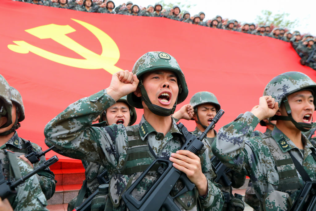Soldiers seen in front of the flag of the Communist Party of China at an official event on April 13, 2021 in Luoyang, Henan Province, China.