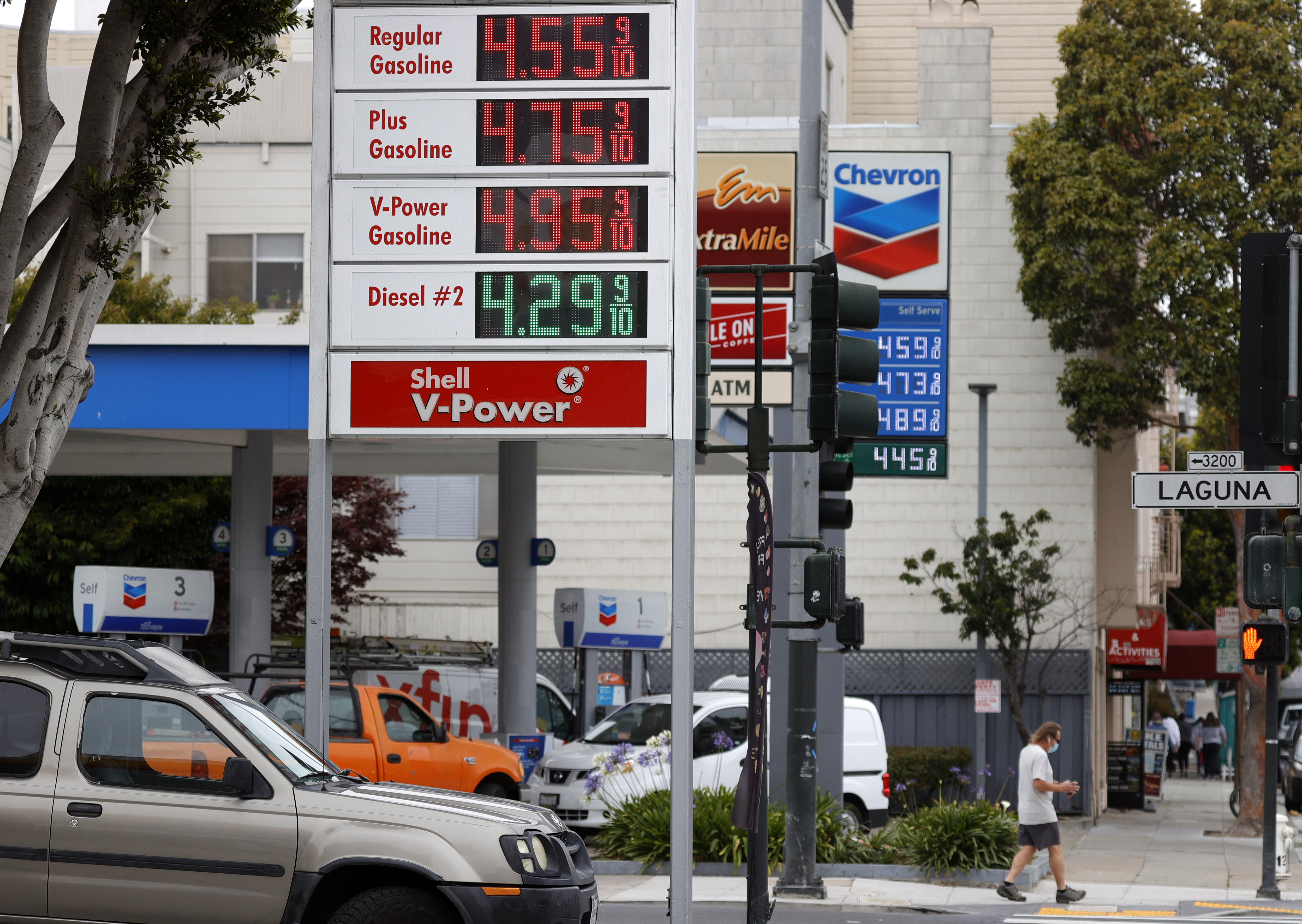 SAN FRANCISCO, CALIFORNIA - JULY 12: Gas prices nearing $5.00 a gallon are displayed at Chevron and Shell stations on July 12, 2021 in San Francisco, California. (Photo by Justin Sullivan/Getty Images)