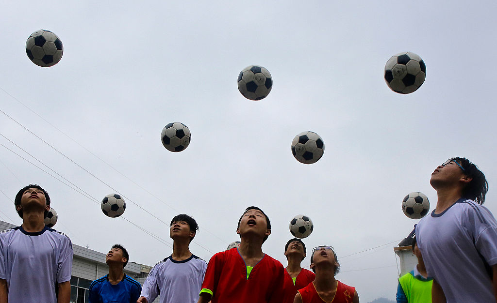 Chinese students are seen during a football training session in the campus of the Yuyang Middle School in Wufeng Tujia Nationality Autonomous County of Yichang on June 1, 2016, in Hubei province, China.