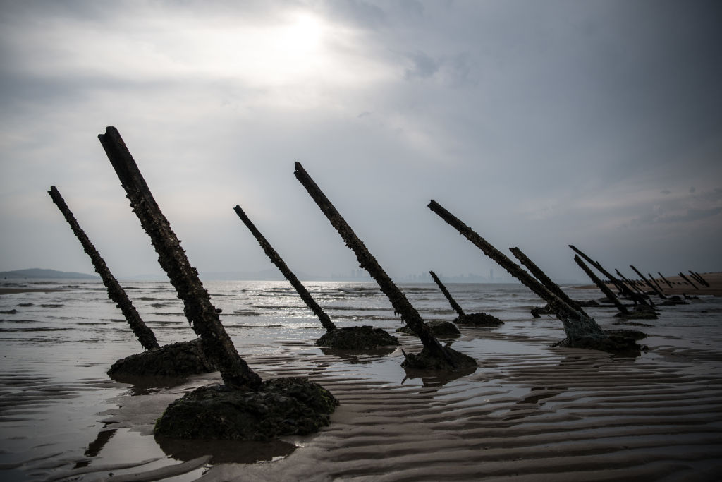 Aged anti-landing barricades are positioned on a beach facing China on the Taiwanese island of Kinmen which, at points lies only a few miles from China, on April 19, 2018 in Kinmen, Taiwan.