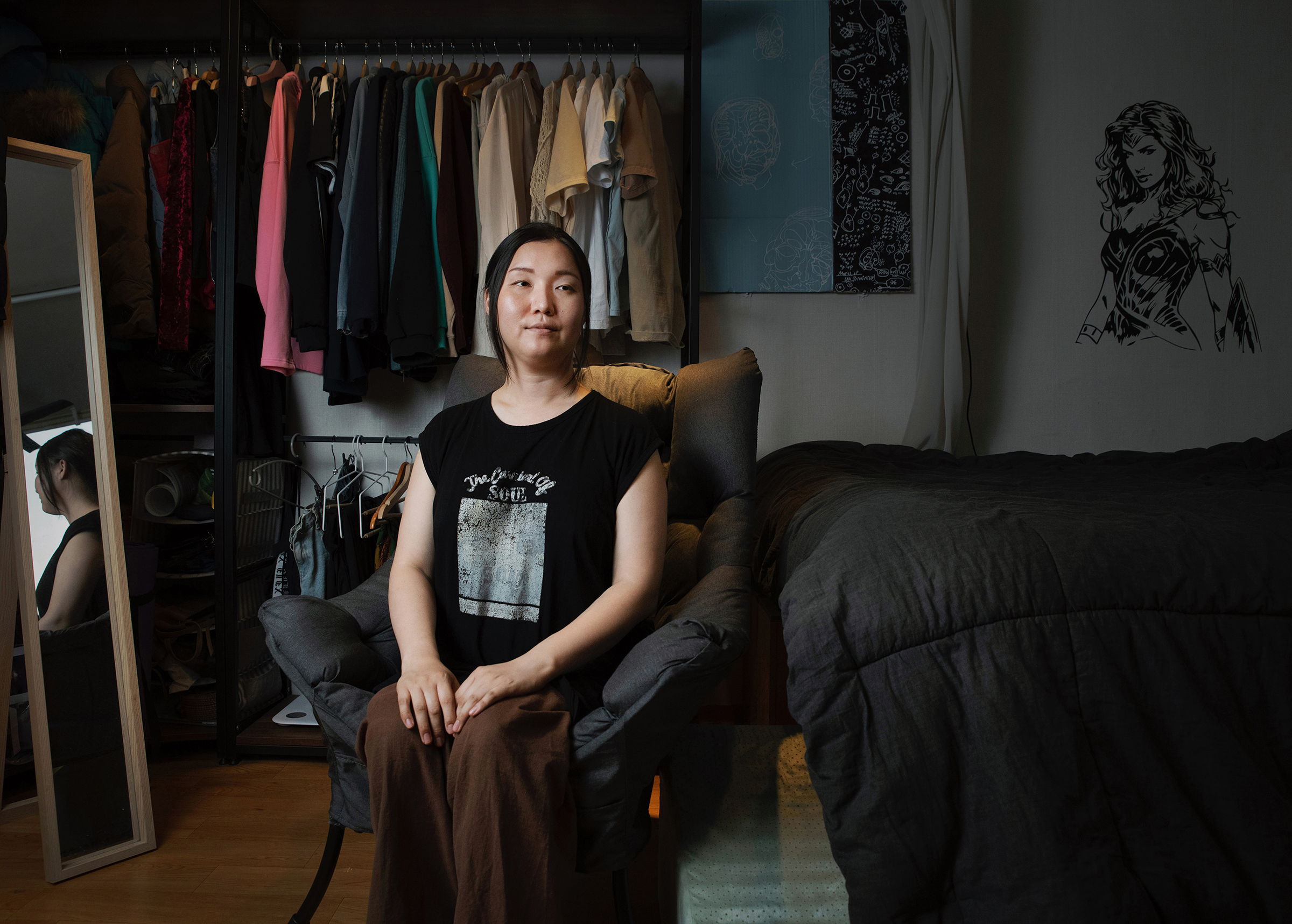 Park Edhi poses for a portrait at her home in Itaewon, Seoul, on June 21. Park moved into this apartment in January 2020, just before the COVID-19 pandemic. Transphobia was also running high.  Hatred was just pouring out. It was an incredibly difficult time,  says Park. Referring to the high-profile dismissal and death of Sgt. Byun Hee-soo, as well as the case of a transgender student who faced backlash for getting acceptance to a women's university, Park says:  Even with gender confirmation surgery, not being able to go to school? Or a transwoman soldier who wanted to serve but couldn't ... What are we supposed to do?  Park says the lack of policies to protect basic rights has left her in a state of hopelessness.  I went to five funerals in two months. You know how, when you get wounded, you put medicine on it and the wound scabs over? I'm in that scab period. And this home is my safe space.