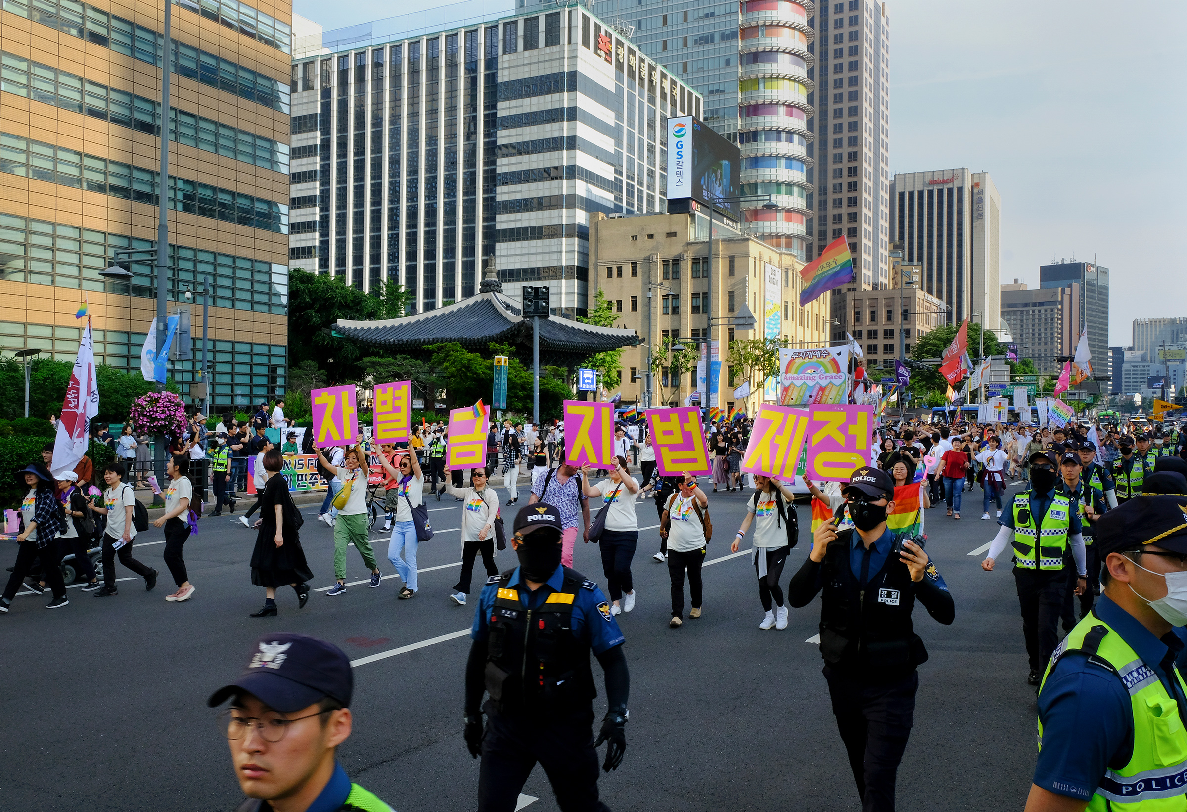 LGBTQ rights protesters hold signs that read,  Enact an Anti-Discrimination Law  at Gwanghwamun Plaza during the Seoul Queer Culture Festival on June 1, 2019.
