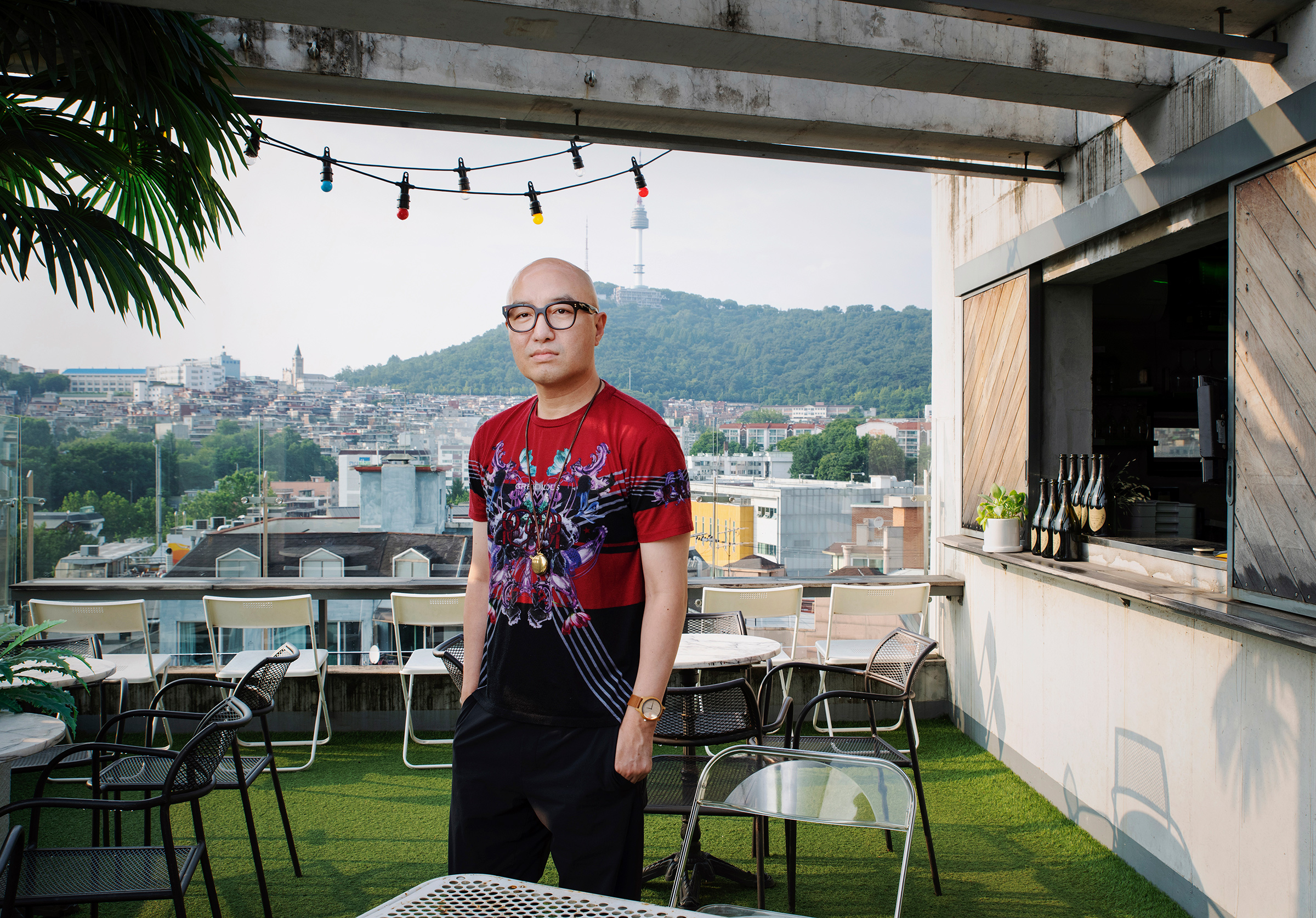 Hong Seok-cheon poses for a portrait in where used to be his rooftop restaurant, My Sky, in Itaewon, Seoul, on June 23.  All around the world, there are neighborhoods here and there that recognize diversity,  he says.  I think in Korea, that's Itaewon. And I realized my dream and spent my youth here.  After coming out in 2000 and being ousted from television jobs, he opened restaurants in the neighborhood.  I wanted to create spaces where LGBTQ people would coexist with the heterosexual community. So I chose restaurants. Of course, it was difficult at first. The people who came to our restaurant had a very preconceived notion because I was the owner. But as time passed, people recognized my sincerity and hard work and really enjoyed those spaces. It's very sad that they are gone.  He says that he feels constant pressure to become a successful LGBTQ role model for Koreans, a burden he has been singularly carrying as the most prominent celebrity who has come out.