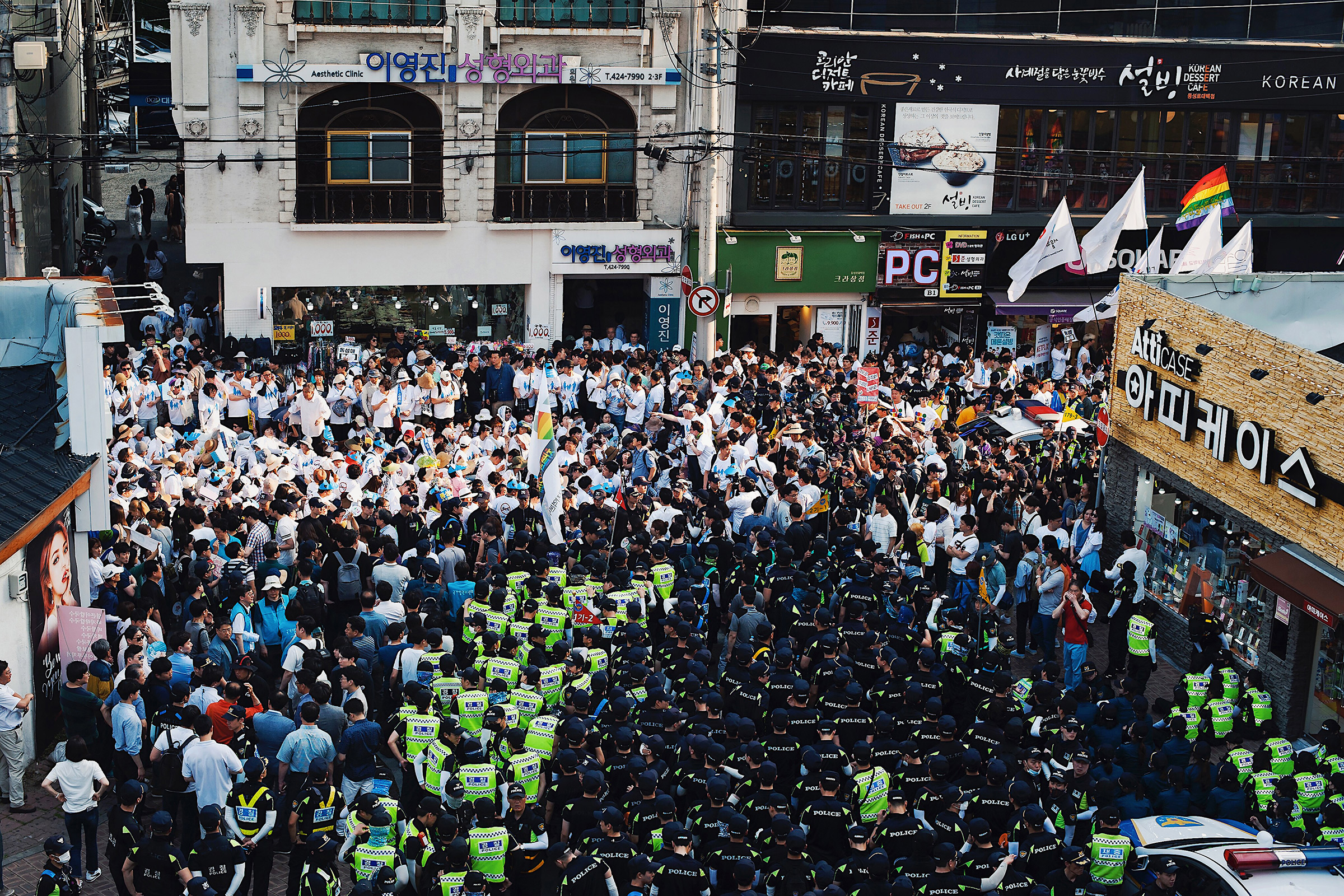 Anti-LGBTQ demonstrators (in white) at Daegu Queer Culture Festival, blocking the LGBTQ parade in June 2018. Over 500 Christianity-affiliated demonstrators sat on the roads near Dongsungro Plaza and sang the Korean national anthem, refusing to make way until the parade was canceled.