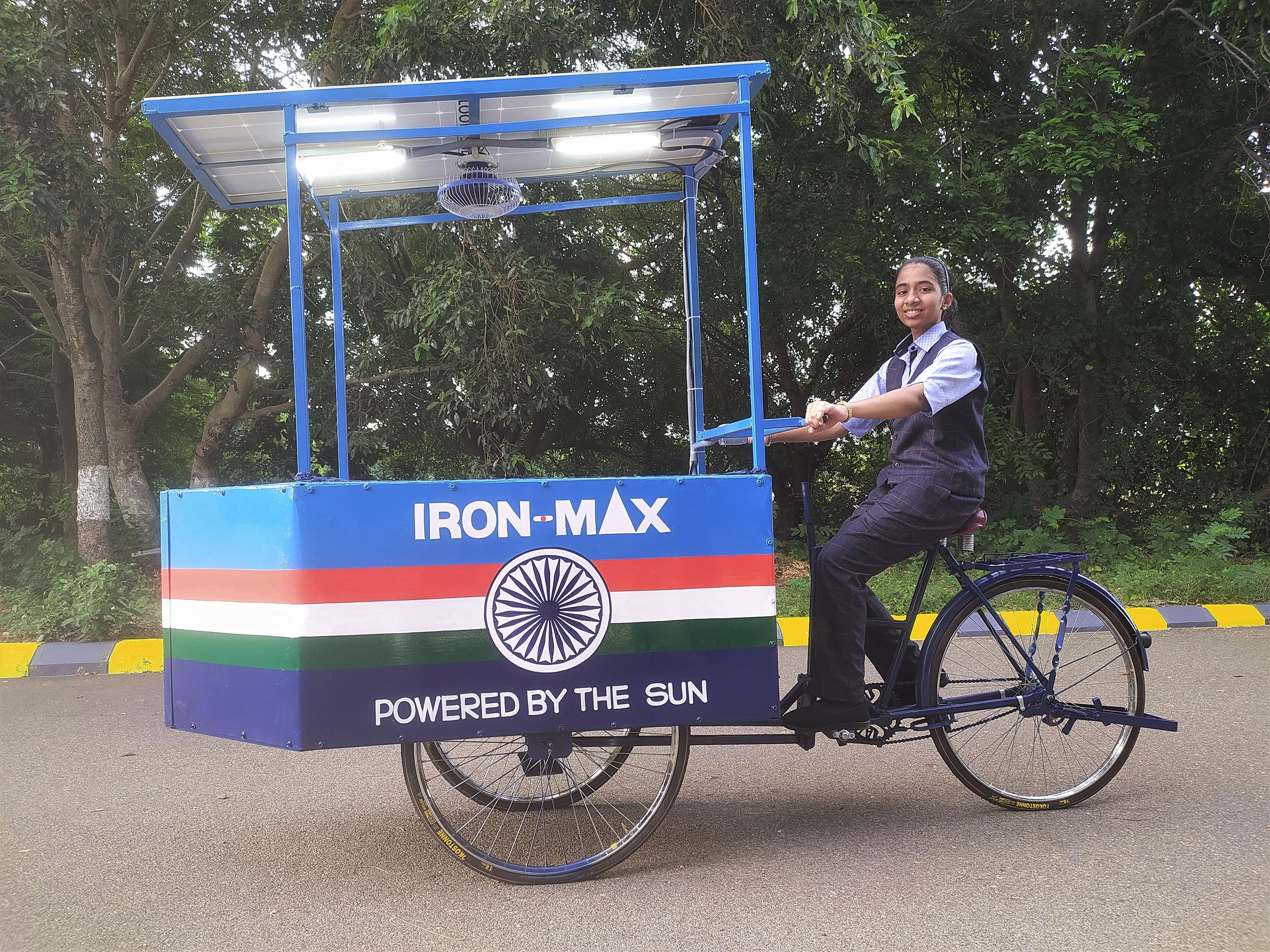 14-year-old Vinisha Umashankar rides the solar-powered iron cart that she designed in Tiruvannamalai, India.