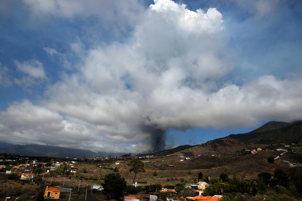 Mount Cumbre Vieja erupts spewing a column of smoke and ash as seen from Los Llanos de Aridane on the Canary island of La Palma on September 19, 2021.