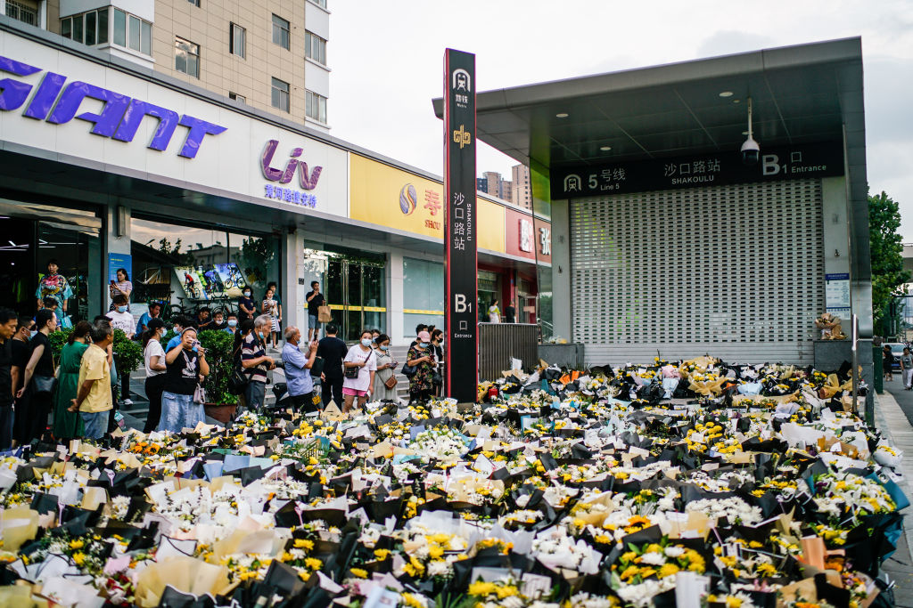 Flowers at the entrance of Shakoulu subway station to mourn those who died after getting trapped in a flooded subway on July 28, 2021 in Zhengzhou, Henan Province of China.