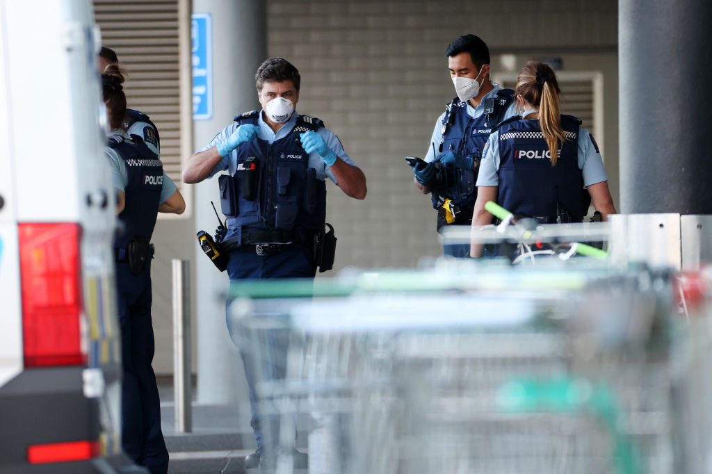 Police guard the area around Countdown LynnMall where a violent extremist reportedly stabbed six people before being shot by police on September 03, 2021 in Auckland, New Zealand.