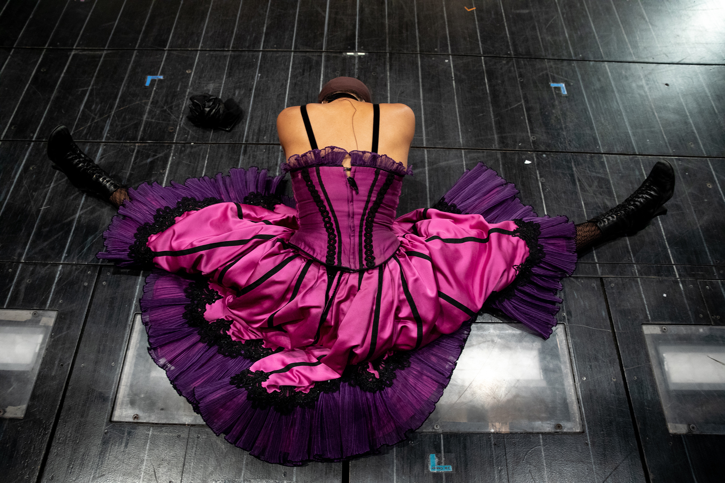 Ensemble member Bahiyah Hibah stretches on stage during rehearsal for Moulin Rouge! on Sept. 21, 2021 in New York, N.Y.