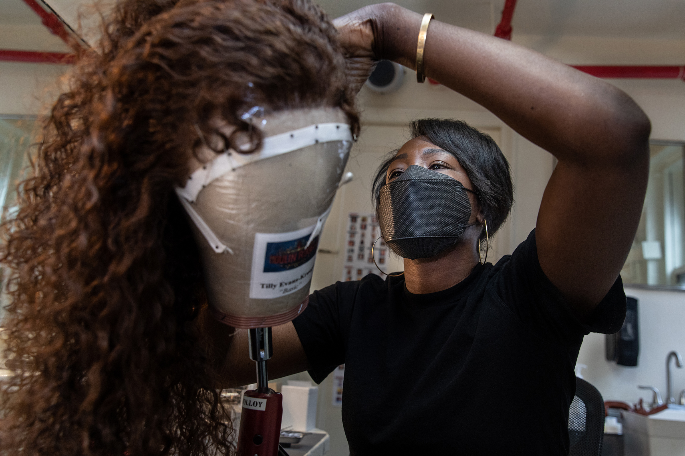 Hairdresser Akilah Abrams prepares a wig in the hair room on Sept. 21, 2021. Moulin Rouge! is her Broadway debut.