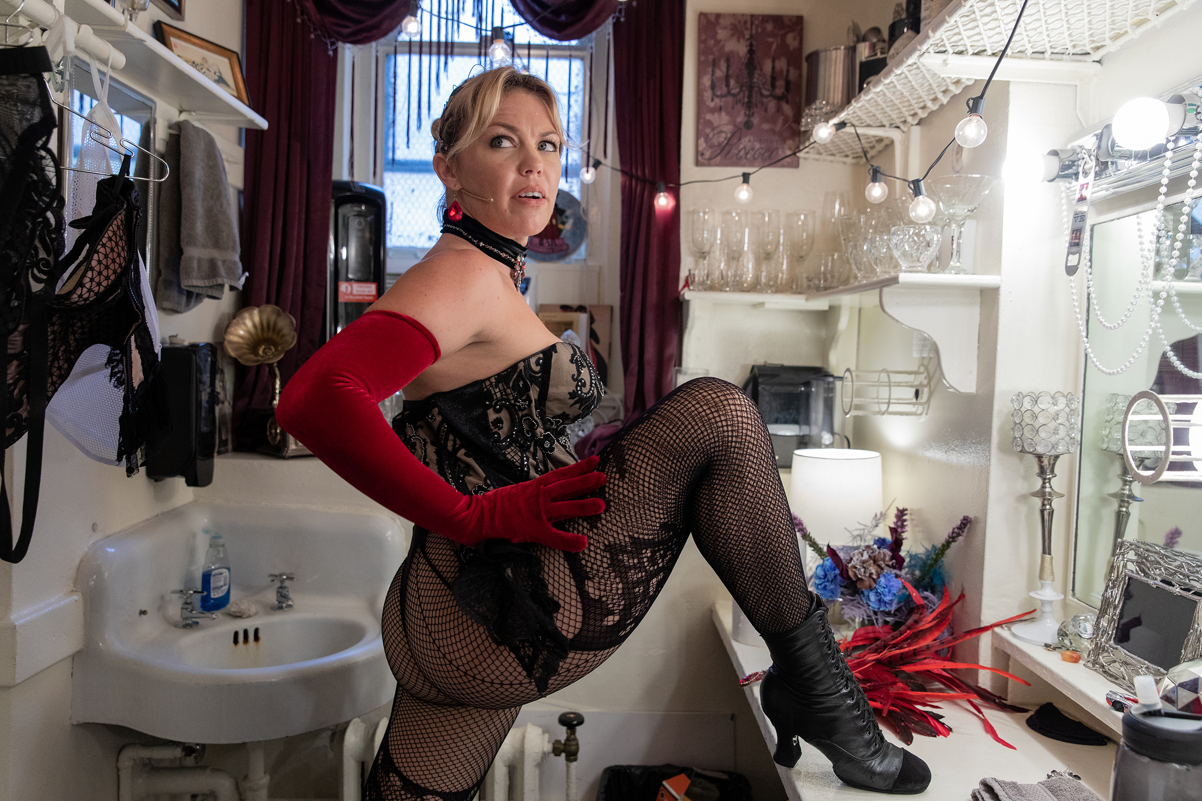 Actress Robyn Hurder who plays Nini in Moulin Rouge! The Musical stretches in her dressing room before a rehearsal in the theater on Sept. 21, 2021 in New York, NY. Hurder is one of the members of the cast and crew who battled covid-19.