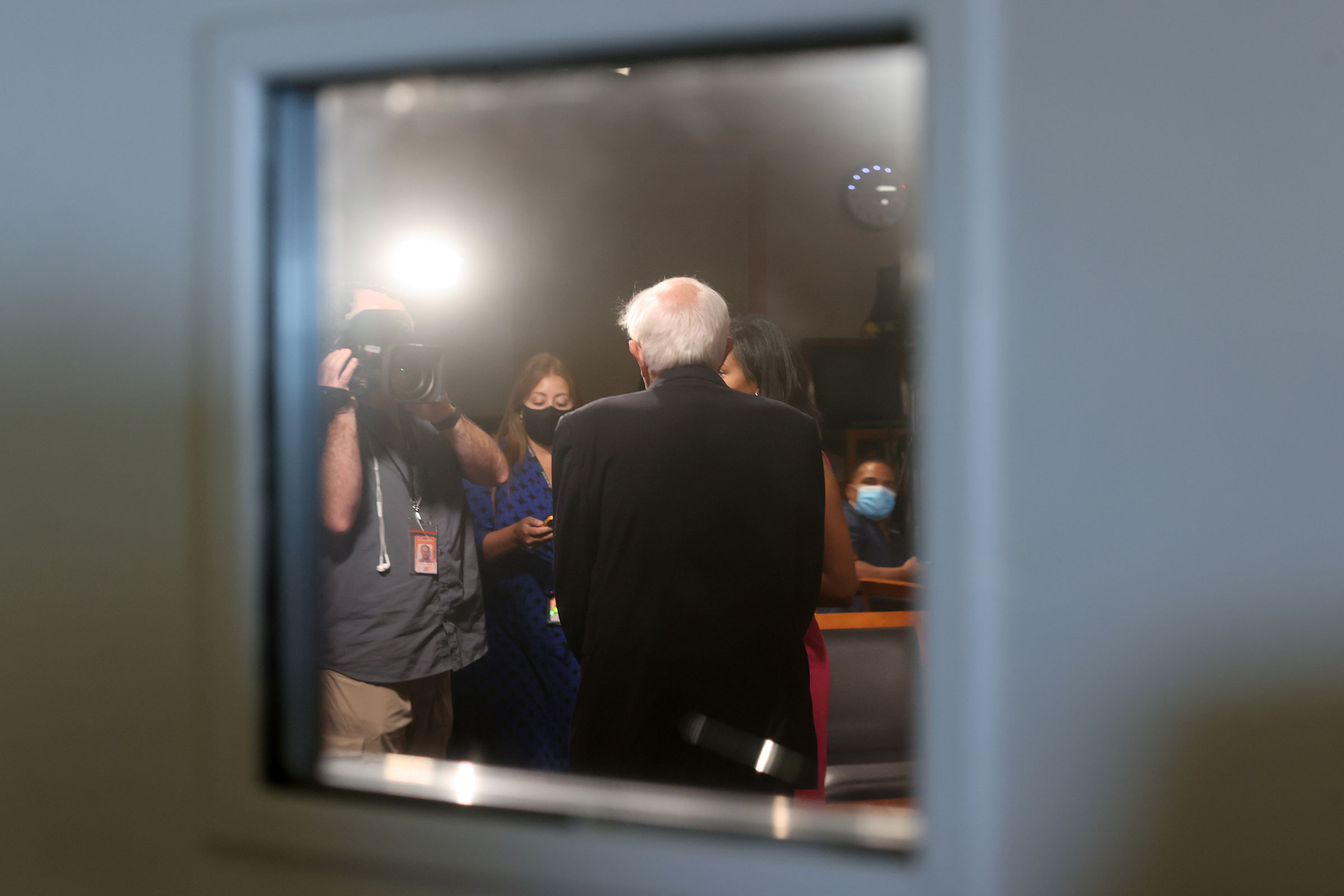 Sanders takes time for a television interview between votes on the Senate floor prior to passage of a $1 trillion bipartisan infrastructure bill on Aug. 10.