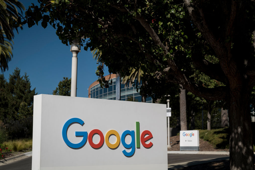 Signage is displayed in front of a building on the Google campus in Mountain View, California, U.S., on Wednesday, Oct. 21, 2020. The U.S. Justice Department sued Alphabet Inc.'s Google in the most significant antitrust case against an American company in two decades, kicking off what promises to be a volley of legal actions against the search giant for allegedly abusing its market power.