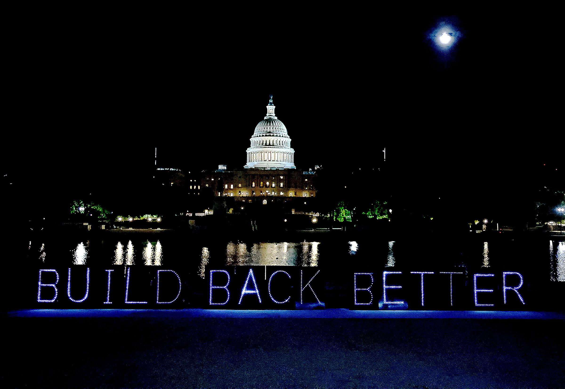 #CareCantWait light projection advocating for the passage of  Build Back Better  budget reconciliation outside of the Capitol in Washington, on Sept. 21, 2021