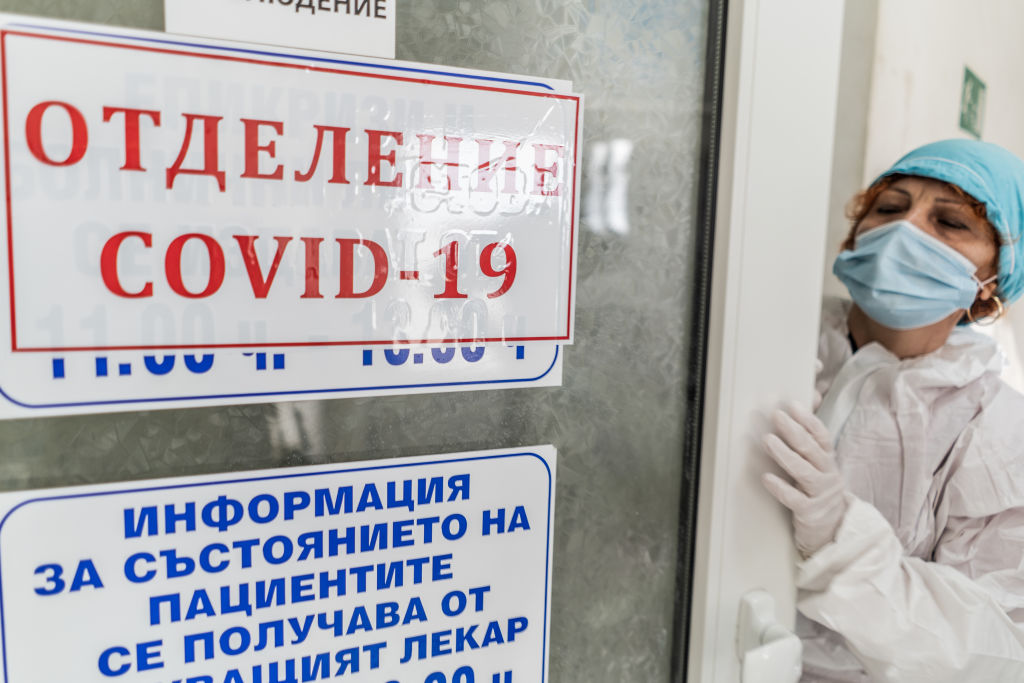 A doctor is seen wearing protective equipment before entering a coronavirus patients room in the ICU of Haskovo Hospital, Bulgaria, on Nov. 5 2020.
