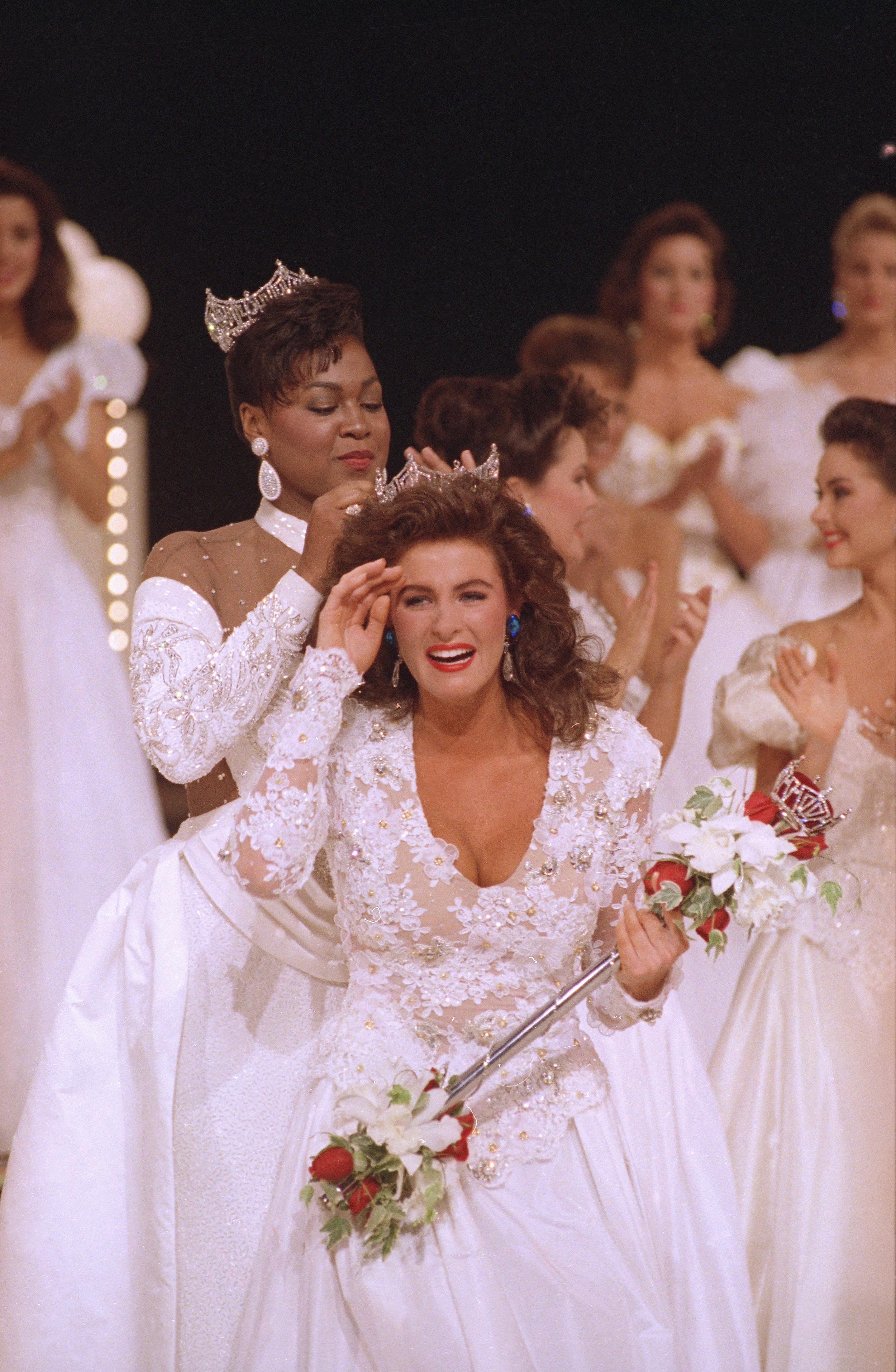 Miss America 1992, Carolyn Sapp of Hawaii, is crowned by former Miss America Marjorie Judith Vincent on Sept. 14, 1991.