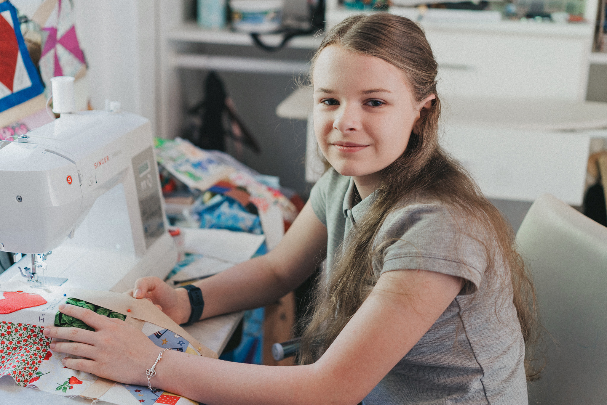 Madeleine Fugate, a 14-year-old in Los Angeles, California, working on a COVID Memorial quilt.