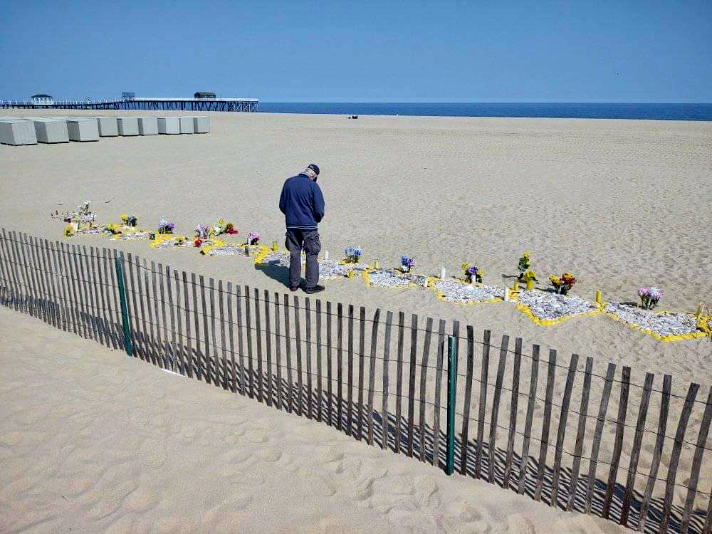A man visiting the memorial set up by Rima Samman in Bel Mar, New Jersey earlier this year.
