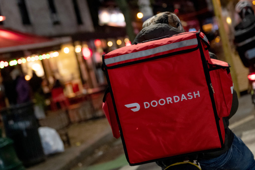 A door-dash delivery driver waits near a restaurant on Dec. 30 2020 in New York City.