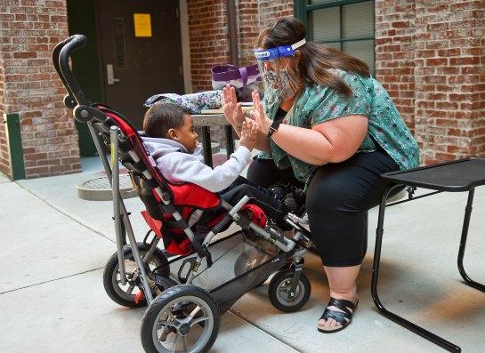 Leslie Esterly works with kindergarten student Levi Wilson, 6, in Oct. 2020.