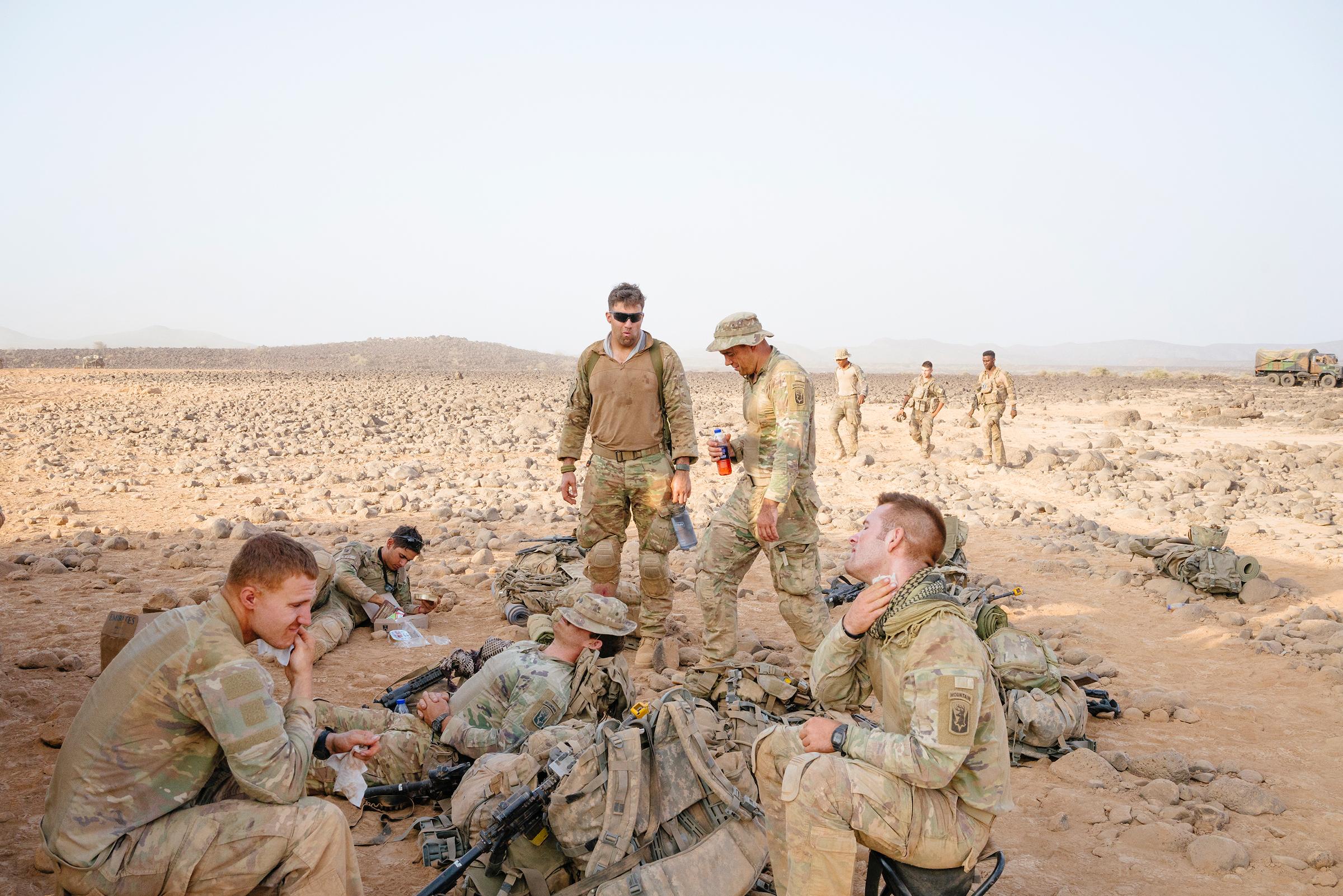 Soldiers take a break during desert training.