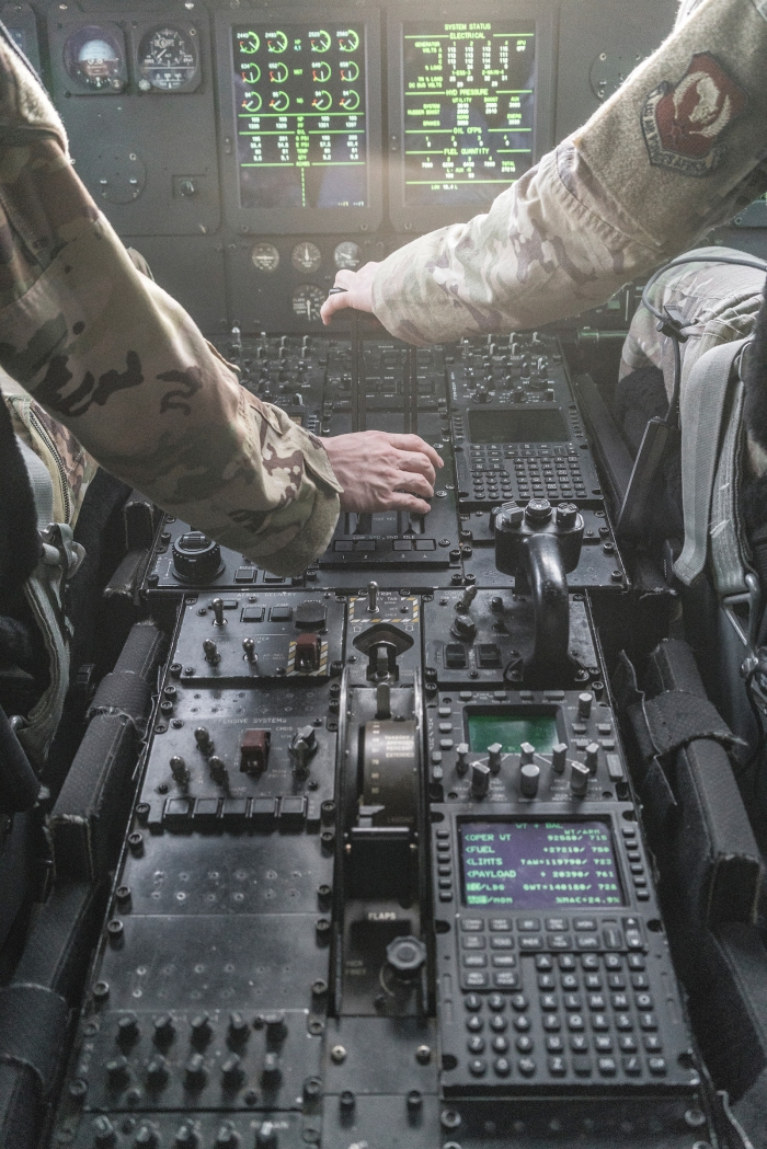 U.S. pilots control a C-130 plane during an emergency exercise above Djibouti.