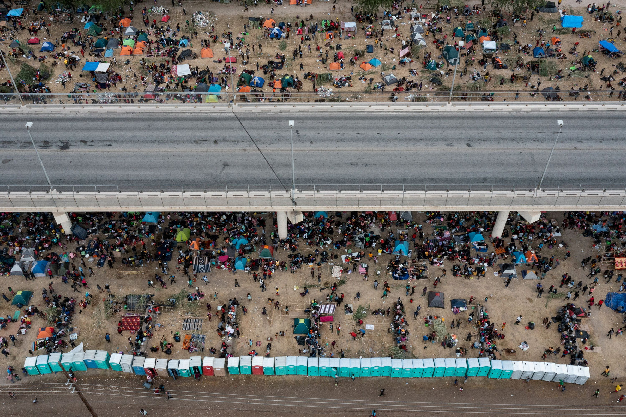 Some thousands of migrants take shelter as they await to be processed near the Del Rio International Bridge after crossing the Rio Grande river into the U.S. from Ciudad Acuna on Sept. 18. Picture taken with a drone.
