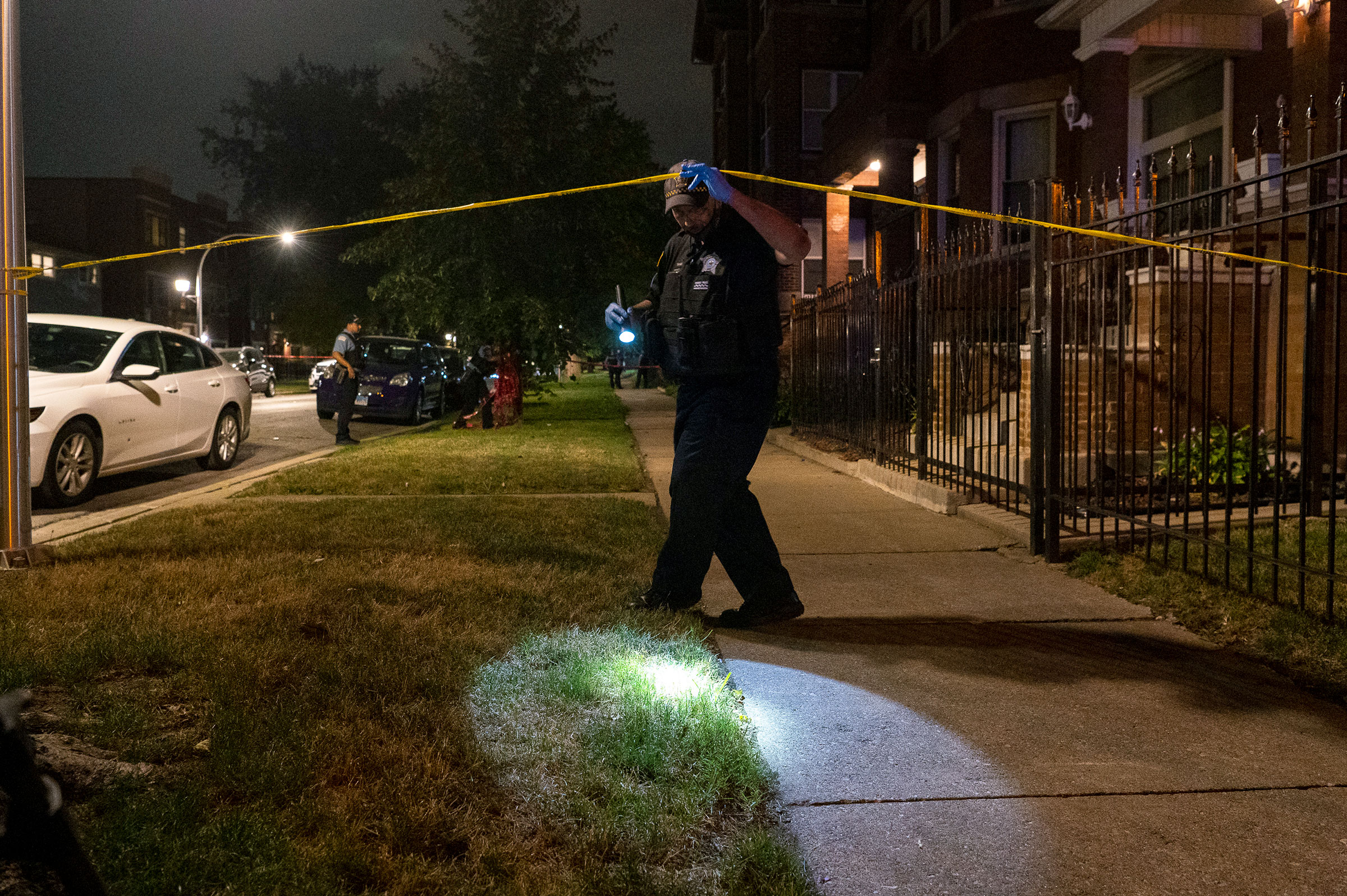 Chicago police at the scene of a shooting in the Woodlawn neighborhood of Chicago, Friday, Sept. 3, 2021. A 4-year-old boy was shot twice when bullets came through the front window of a home, Chicago Police said.