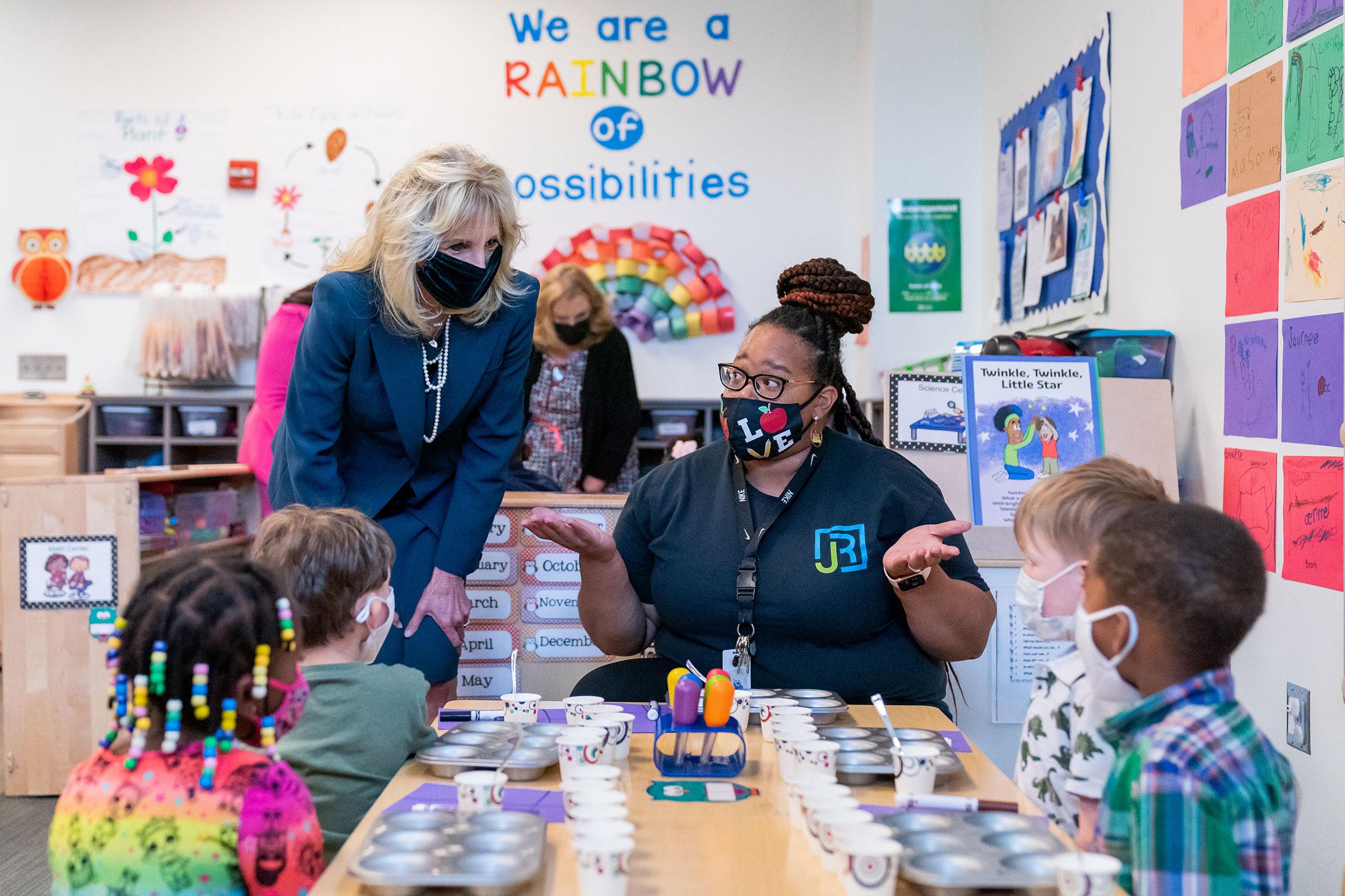 Biden with a HeadStart teacher and children in Alabama in 2021