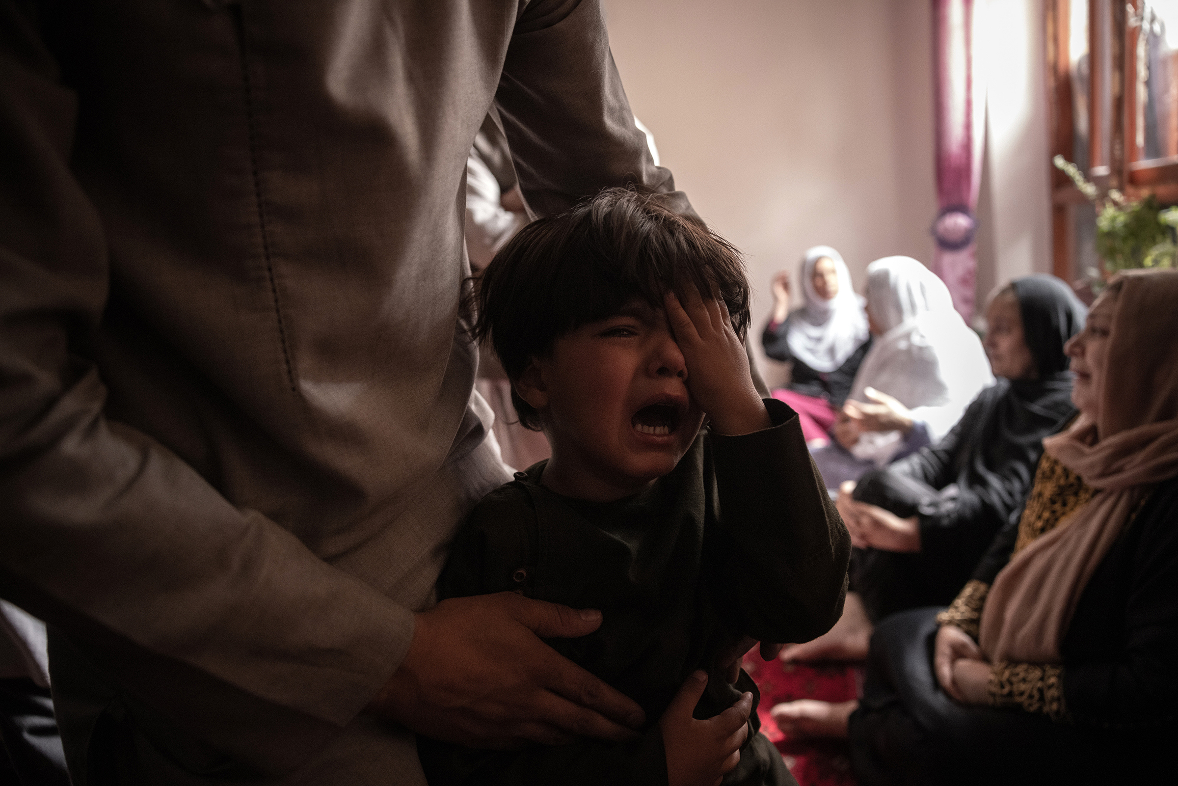 A boy cries over the death of his sister in the drone strike.