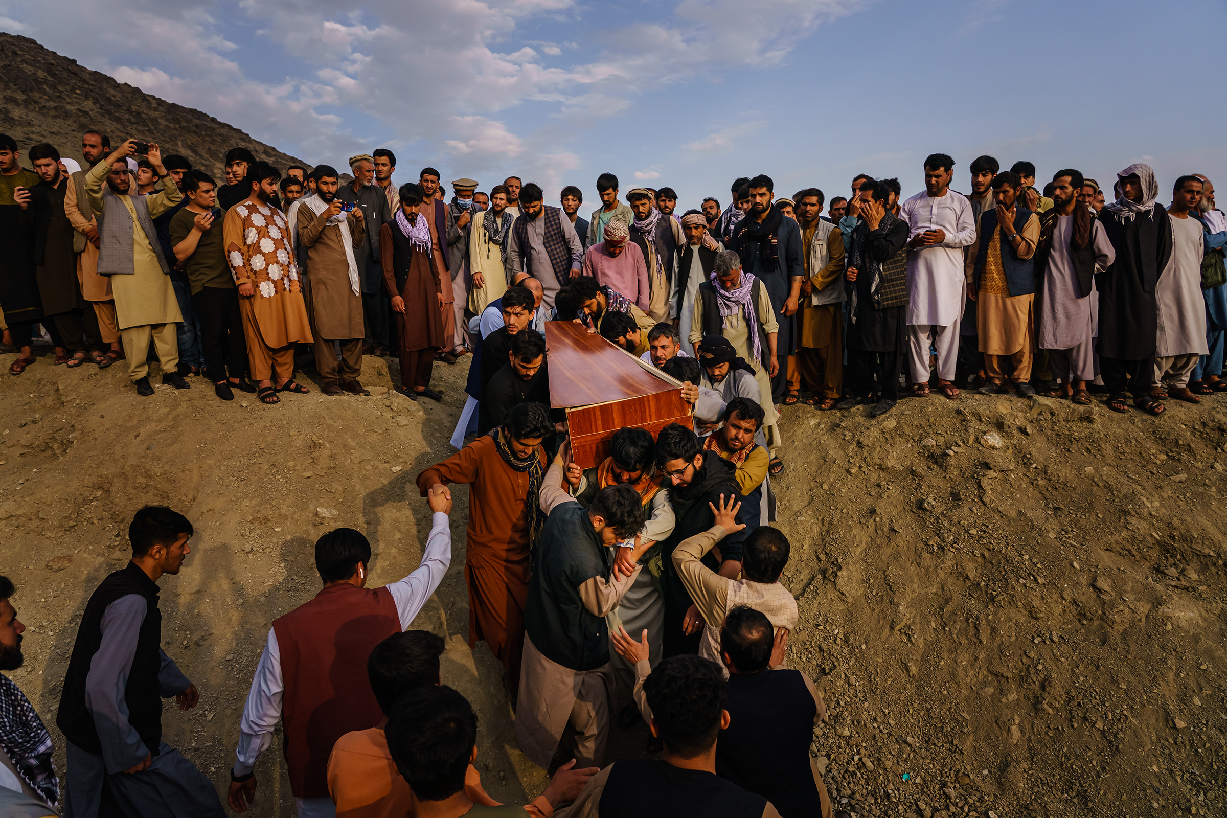 Relatives and friends attend a mass funeral on Aug. 30 for members of the family killed in the strike.