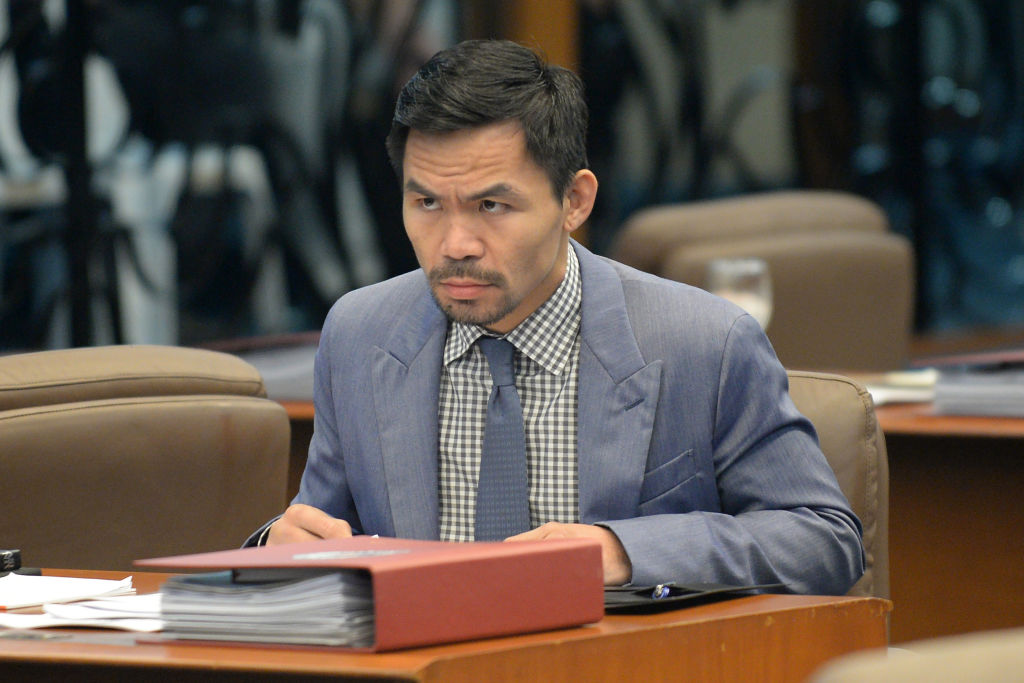 Philippine boxing icon and Senator Manny Pacquiao attends a senate session in Manila on February 13, 2017.