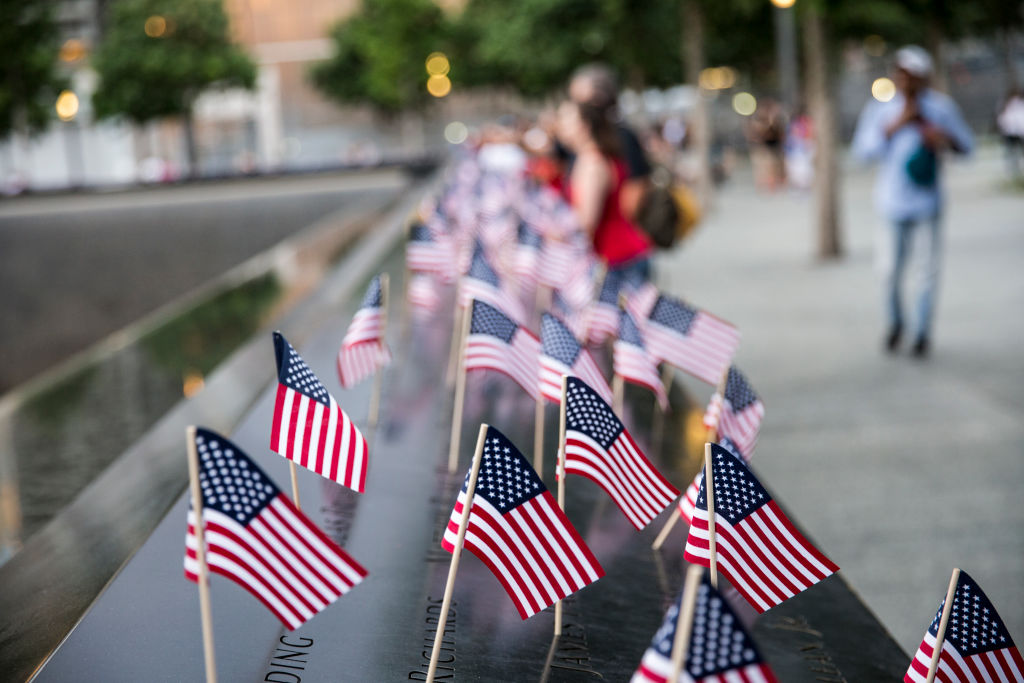 Small American flags are placed in all 2,983 names on the 9/11 Memorial on July 4, 2017, in New York City.
