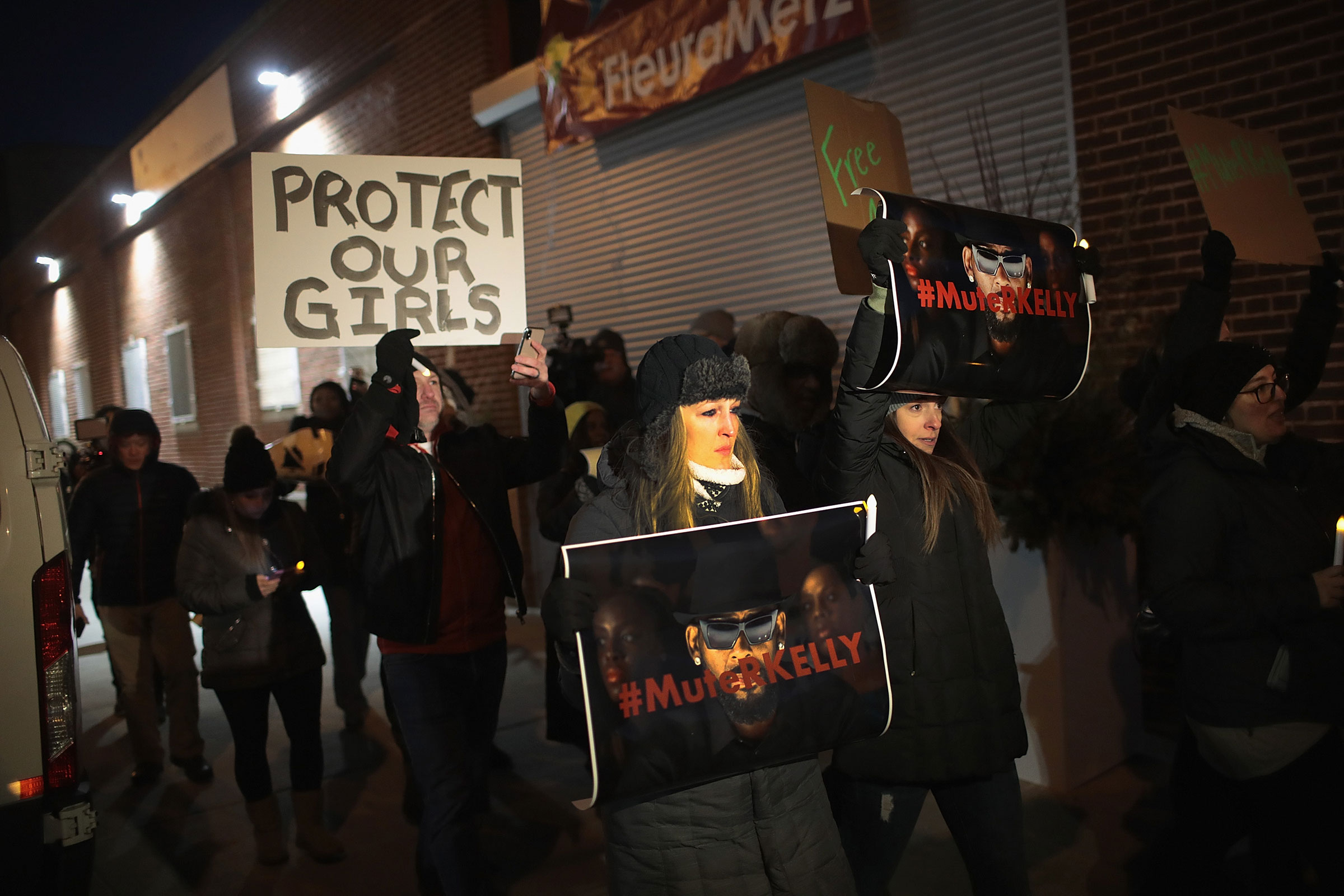 Demonstrators gather near the studio of singer R. Kelly to call for a boycott of his music after allegations of sexual abuse against young girls in Chicago, on Jan. 09, 2019.